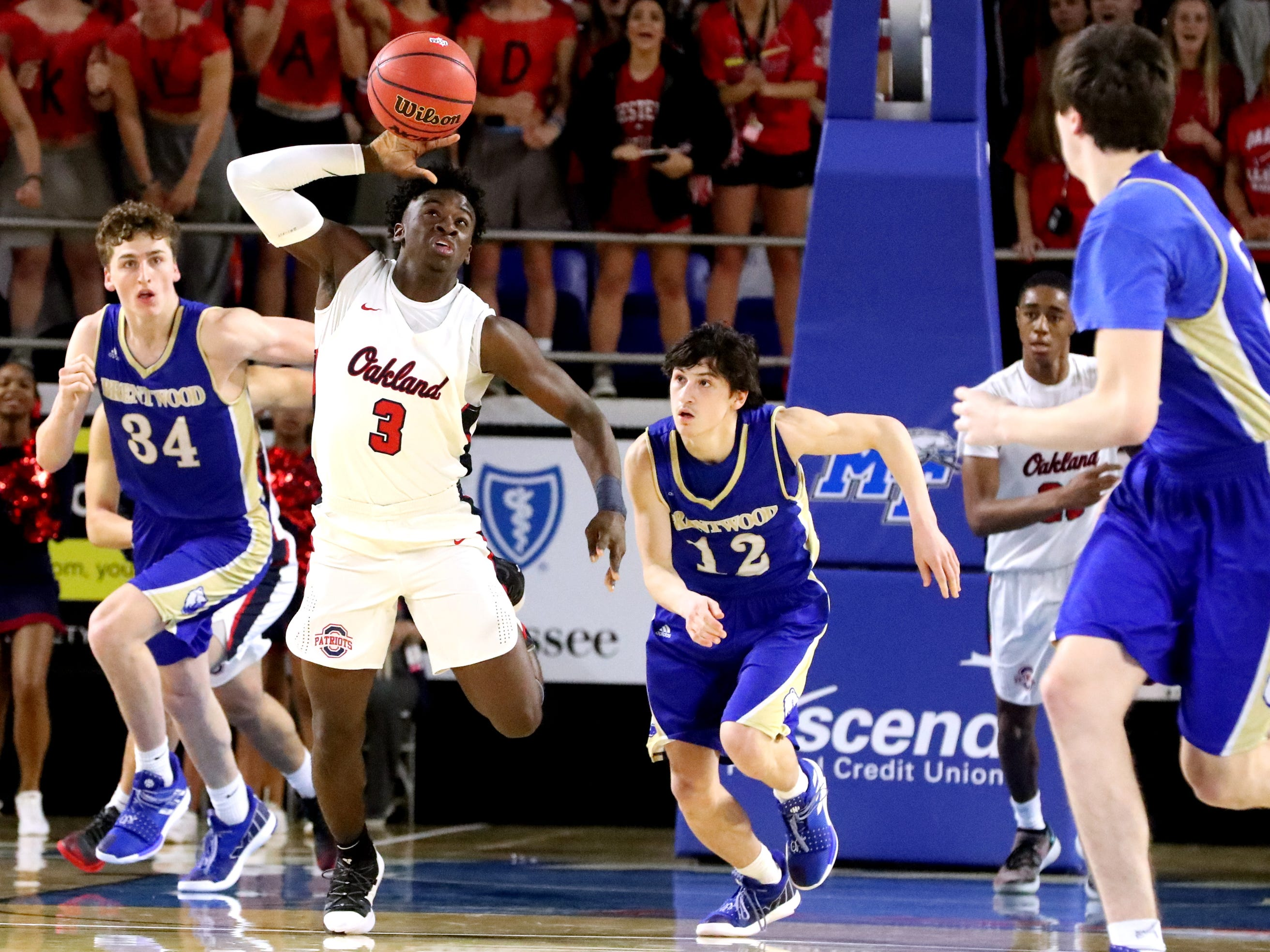 Oakland's Dearre McDonald (3) grabs a loose ball and  brings the ball up court during the quarterfinal round of the TSSAA Class AAA Boys State Tournament, on Thursday, March 14, 2019, at Murphy Center in Murfreesboro, Tenn.