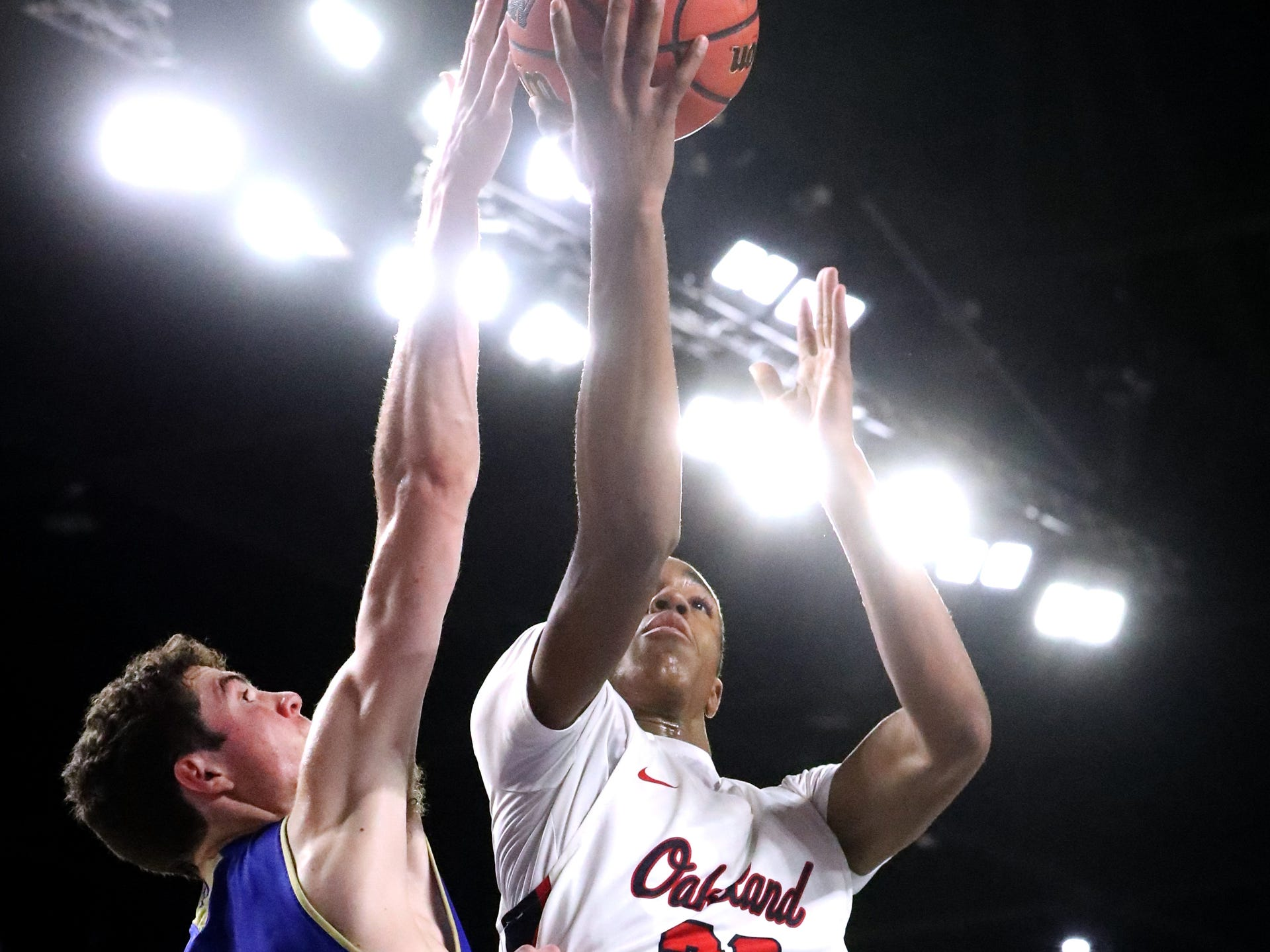 Oakland's Dorian Anderson (23) shoots the ball as Brentwood's John Windley (10) guards him during the quarterfinal round of the TSSAA Class AAA Boys State Tournament, on Thursday, March 14, 2019, at Murphy Center in Murfreesboro, Tenn.