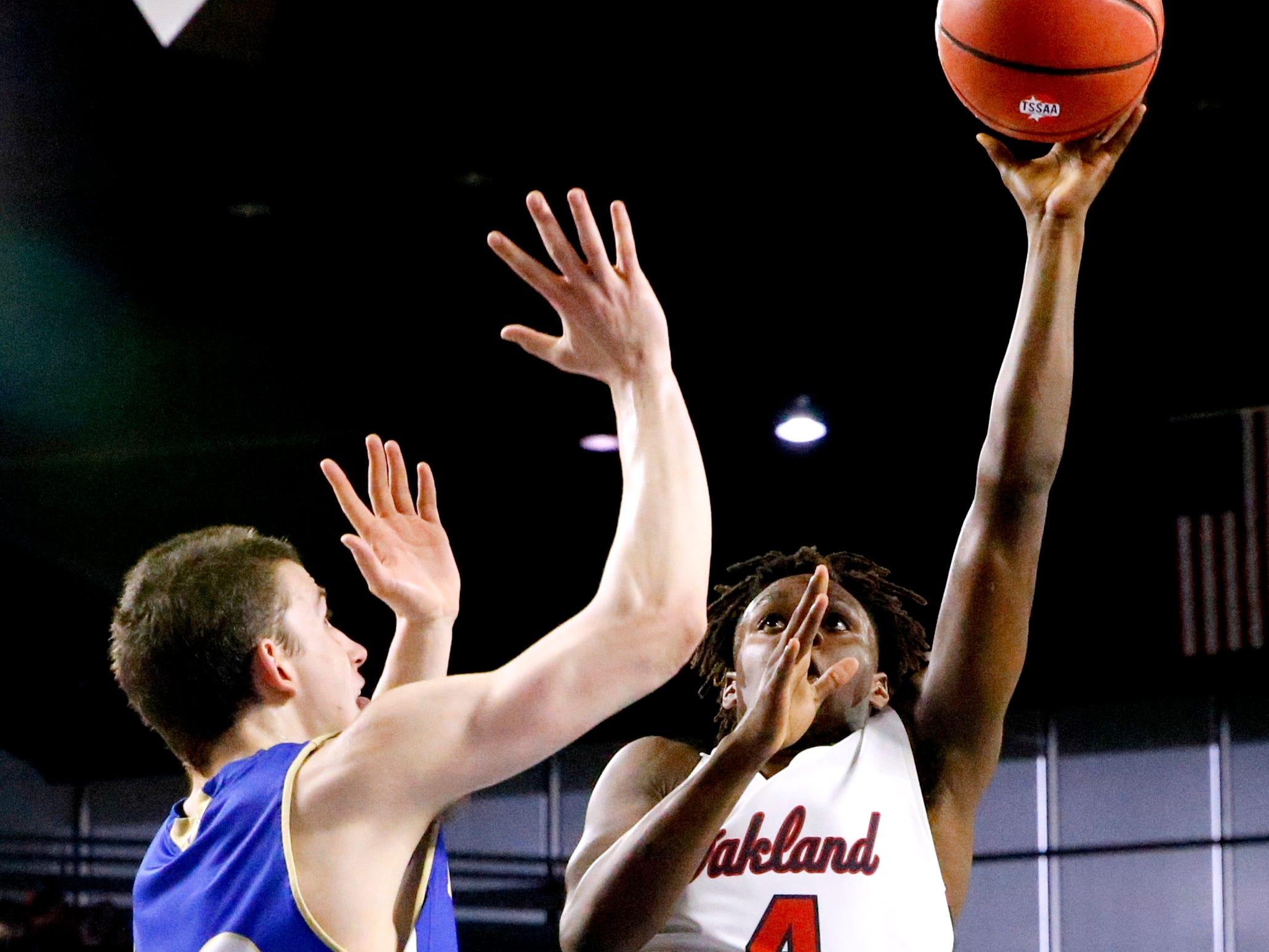 Oakland's Mandrell Grant (4) shoots the ball as Brentwood's Harry Lackey (22) guards him during the quarterfinal round of the TSSAA Class AAA Boys State Tournament, on Thursday, March 14, 2019, at Murphy Center in Murfreesboro, Tenn.