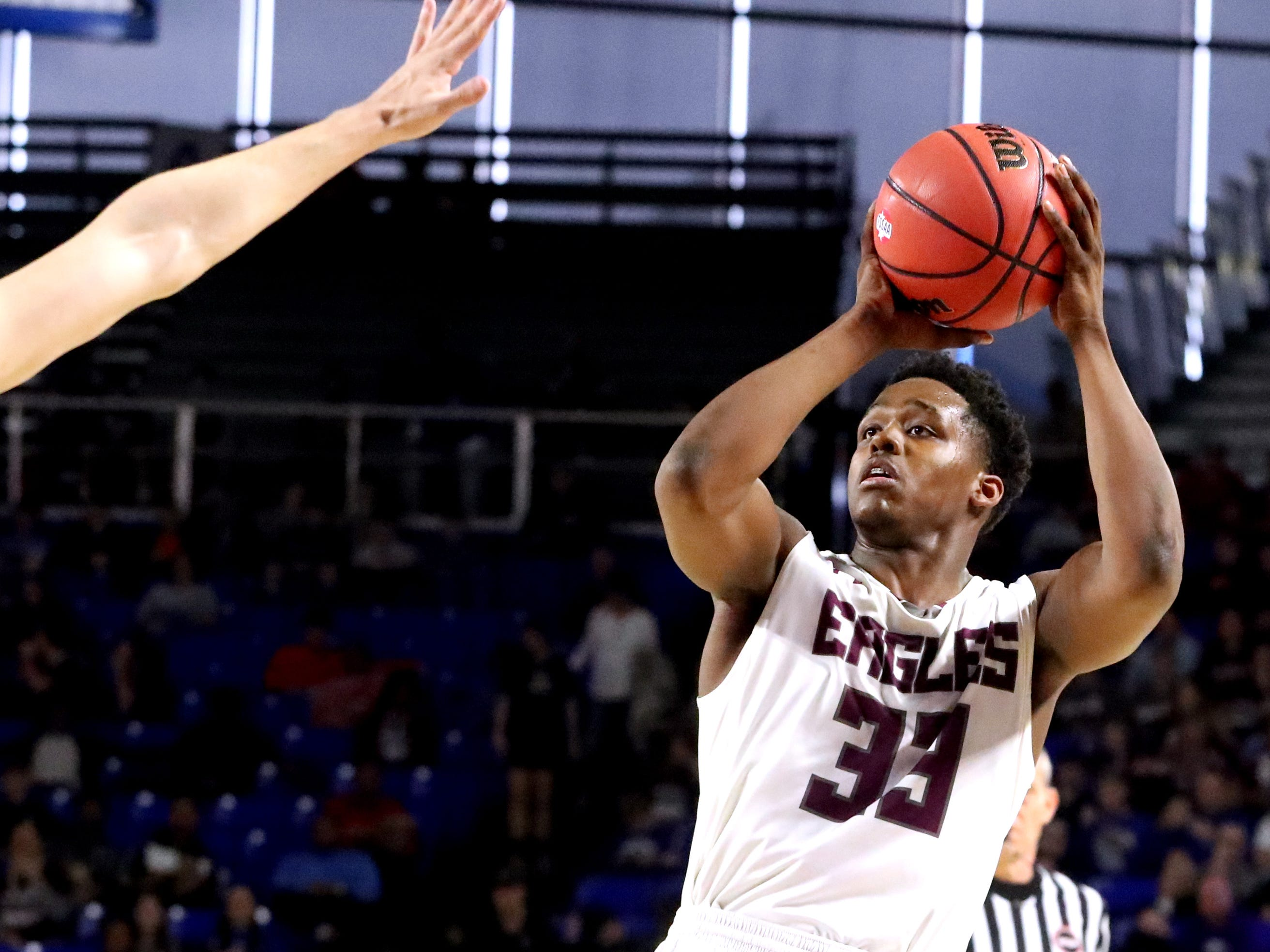 Eagleville's Demarious Stoudemire (33) shoots the ball during the quarterfinal round of the TSSAA Class A Boys State Tournament against Cosby, on Thursday, March 14, 2019, at Murphy Center in Murfreesboro, Tenn.