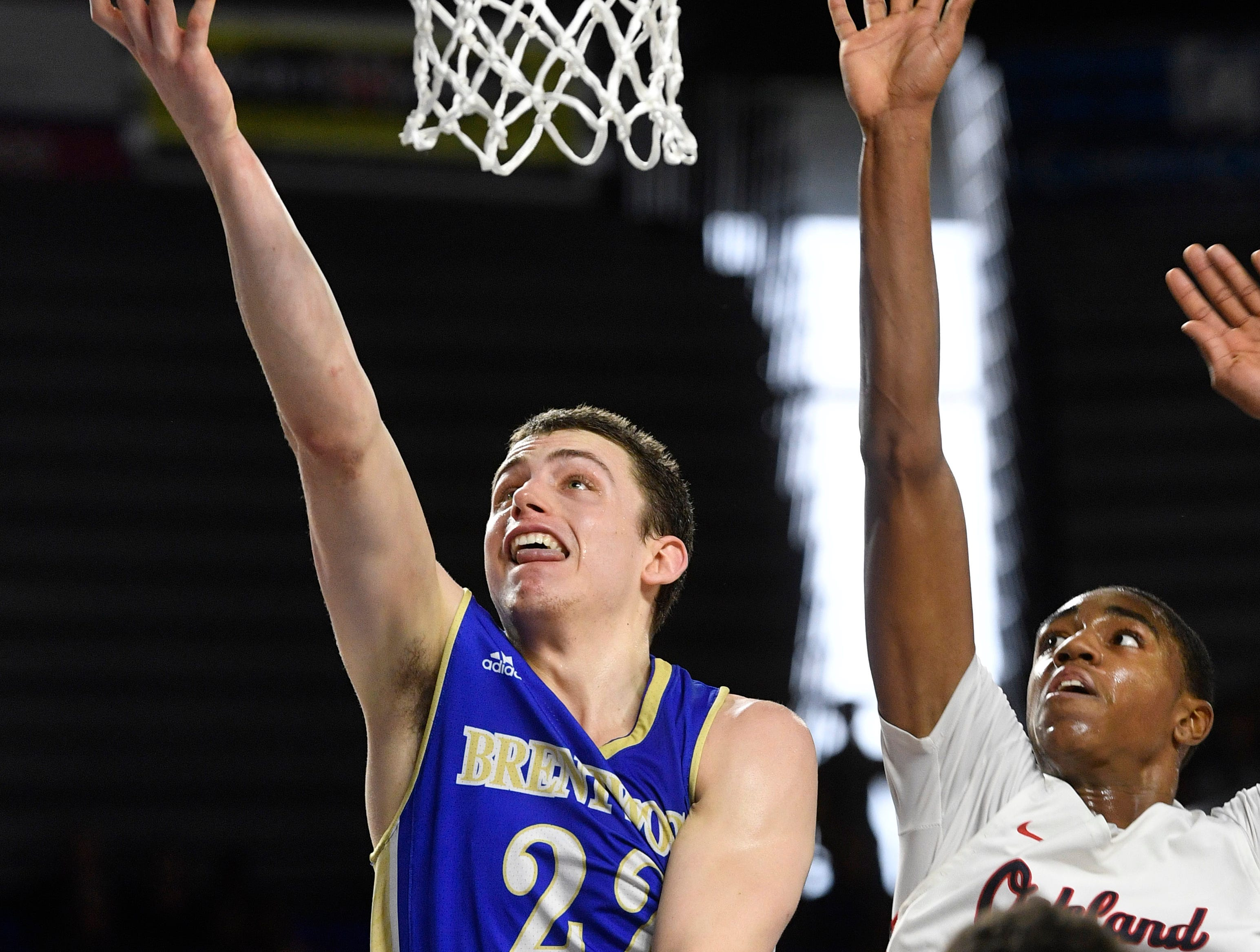 Brentwood's Harry Lackey (22) goes for the layup as Brentwood plays Oakland in the TSSAA Class AAA quarterfinals  Thursday, March 14, 2019, in Murfreesboro, Tenn.