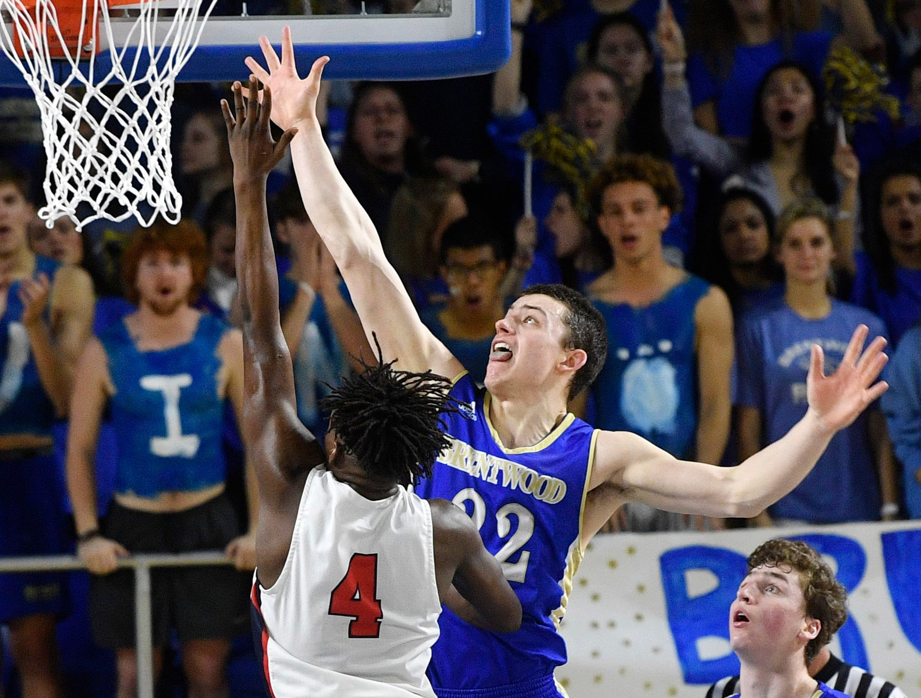 Brentwood's Harry Lackey (22) tries to block Oakland's Mandrell Grant (4) as Brentwood plays Oakland iin the TSSAA Class AAA quarterfinals  Thursday, March 14, 2019, in Murfreesboro, Tenn.