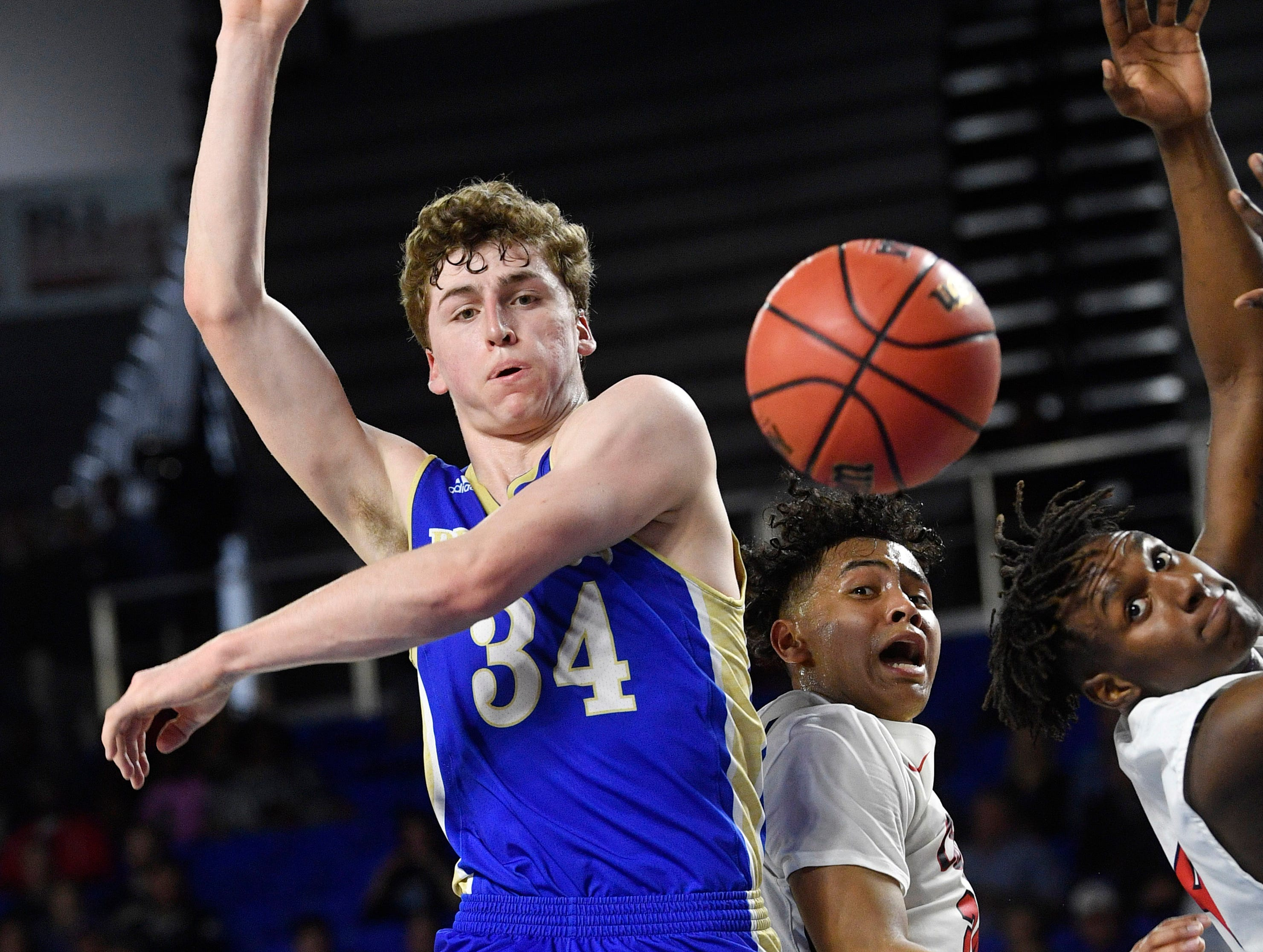 Brentwood's Ben Mills (34) goes for a rebound as Brentwood plays Oakland in the TSSAA Class AAA quarterfinals Thursday, March 14, 2019, in Murfreesboro, Tenn.