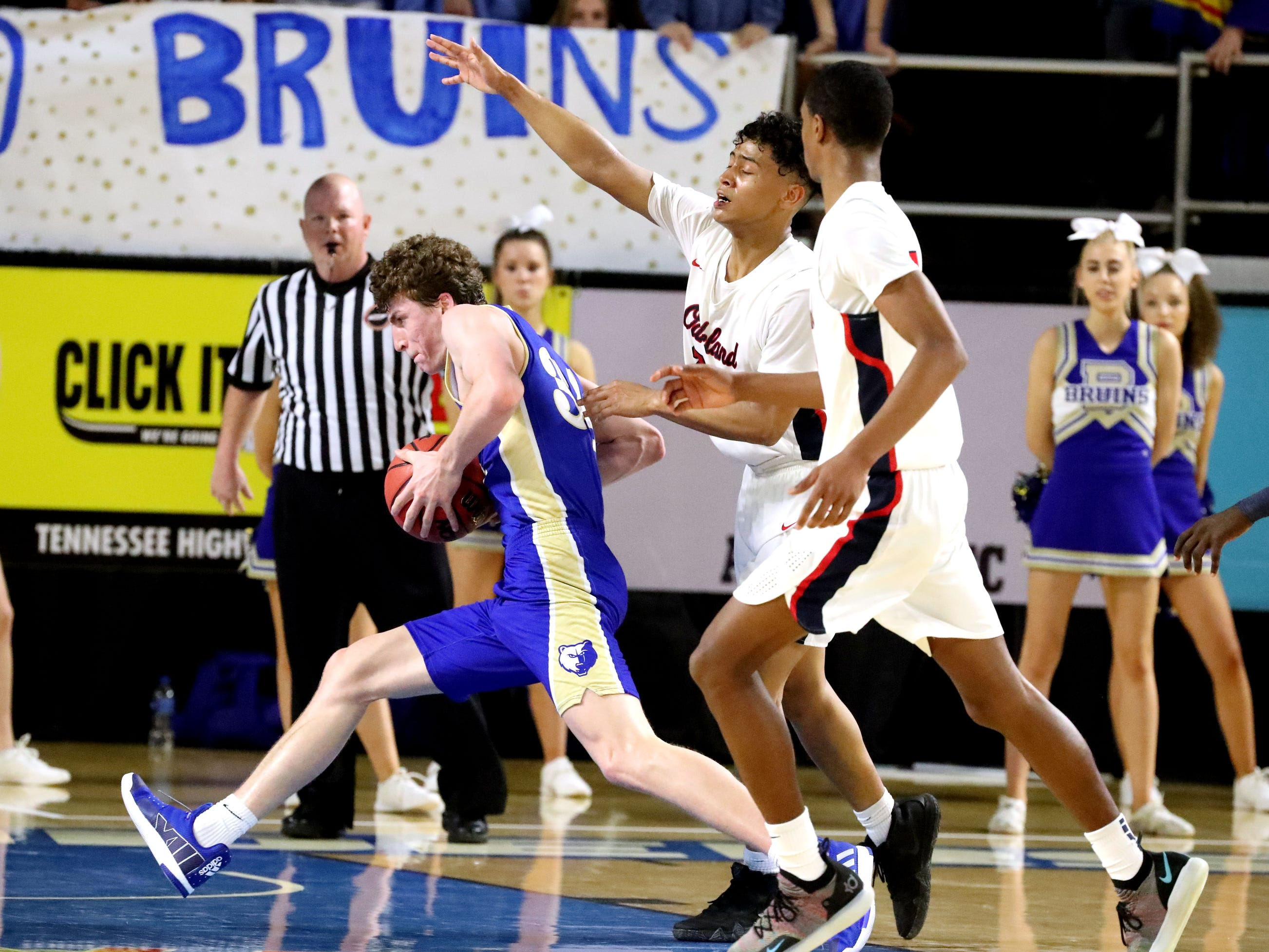 Brentwood's Ben Mills (34) drives to the basket as Oakland's Jaden Jamison (24) and Oakland's Dorian Anderson (23) guards him during the quarterfinal round of the TSSAA Class AAA Boys State Tournament, on Thursday, March 14, 2019, at Murphy Center in Murfreesboro, Tenn.