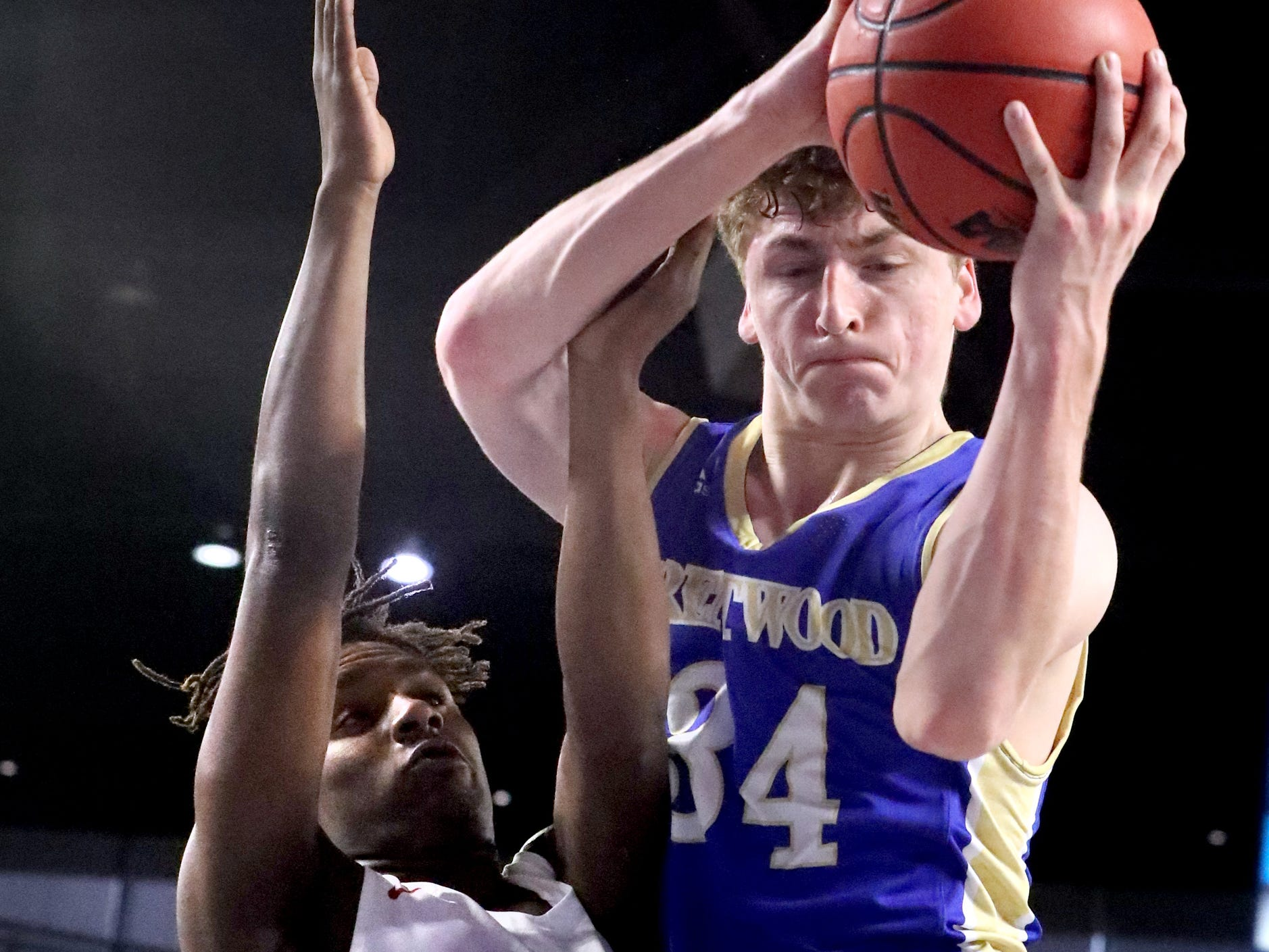 Brentwood's Ben Mills (34) grabs a rebound as Oakland's Mandrell Grant (4) guards him during the quarterfinal round of the TSSAA Class AAA Boys State Tournament, on Thursday, March 14, 2019, at Murphy Center in Murfreesboro, Tenn.