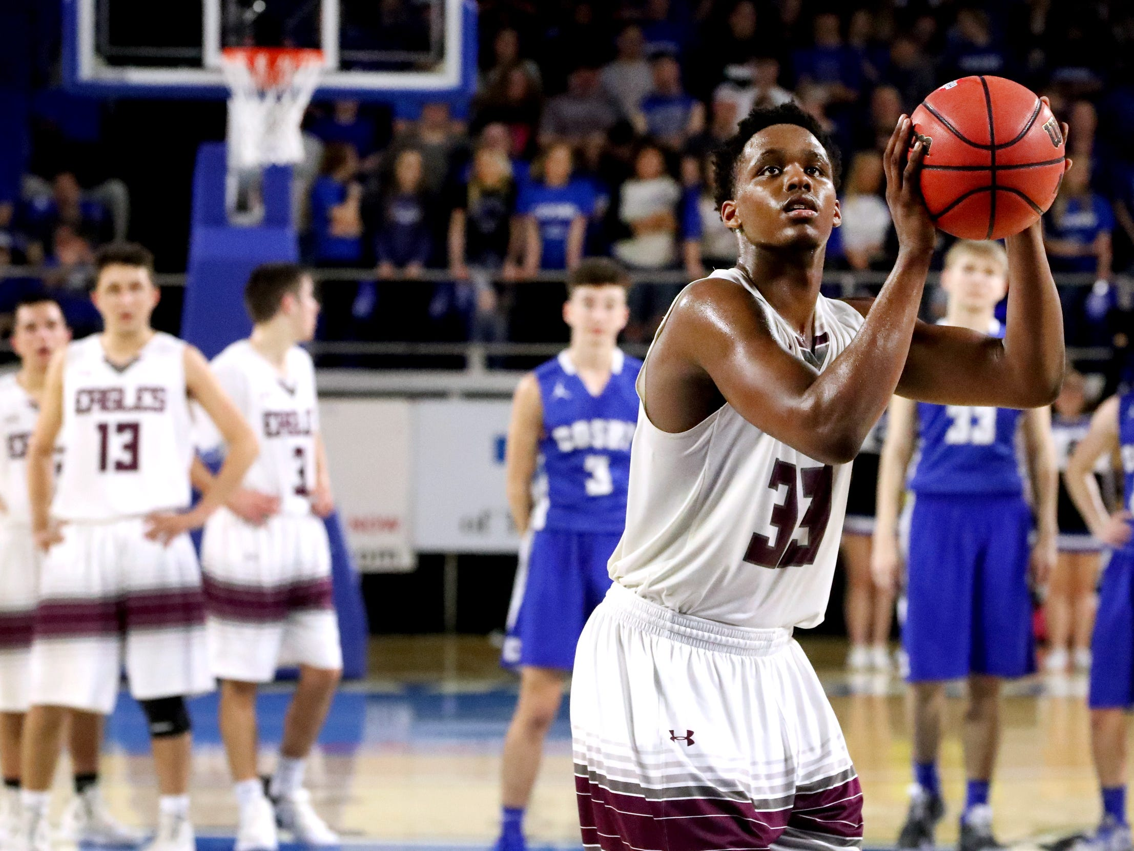 Eagleville's Demarious Stoudemire (33) shoots a free throw after after a technical was called on Cosby during the quarterfinal round of the TSSAA Class A Boys State Tournament, on Thursday, March 14, 2019, at Murphy Center in Murfreesboro, Tenn.