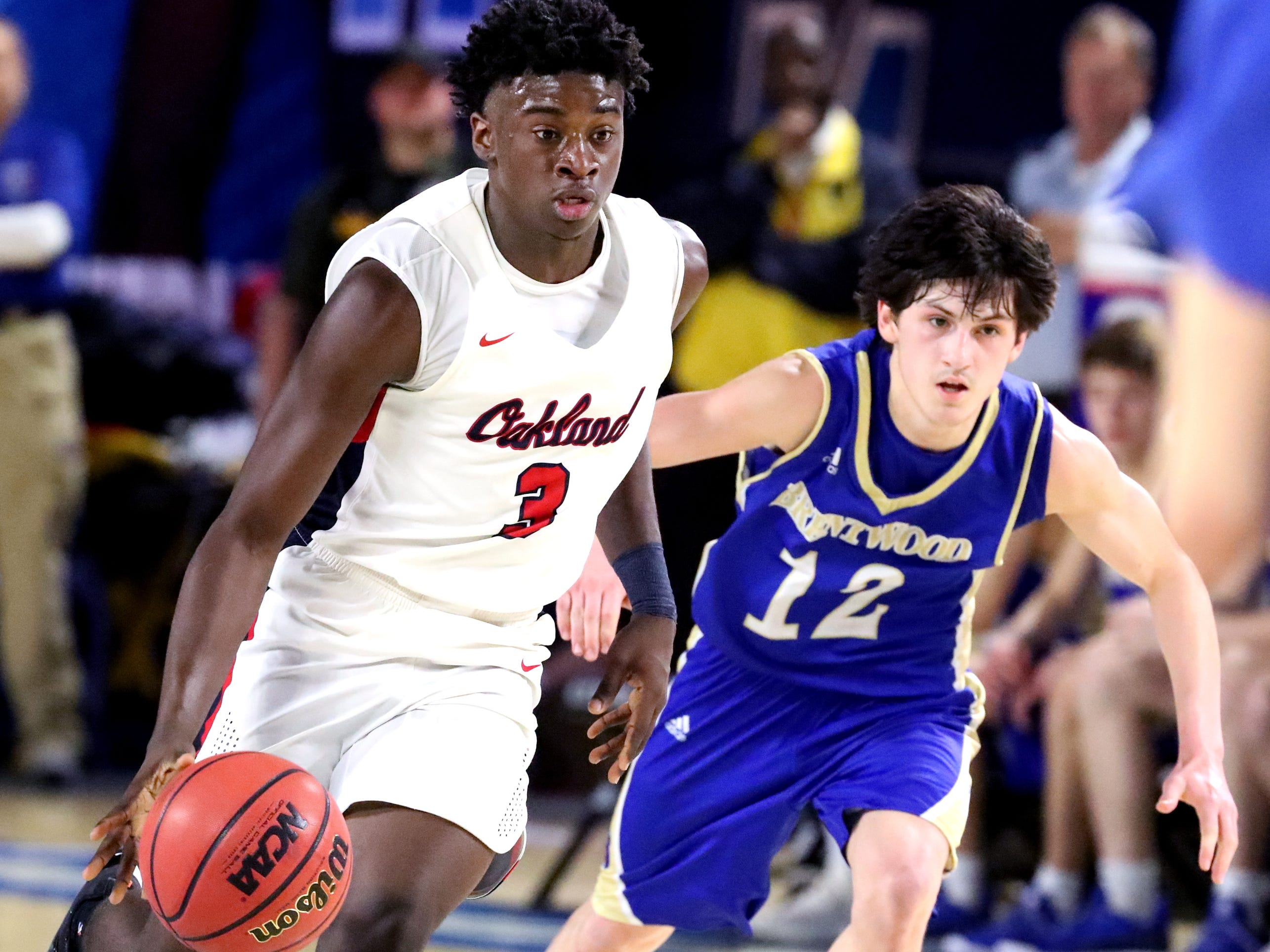Oakland's Dearre McDonald (3) brings the ball up court as Brentwood's Preston Moore (12) guards him during the quarterfinal round of the TSSAA Class AAA Boys State Tournament, on Thursday, March 14, 2019, at Murphy Center in Murfreesboro, Tenn.