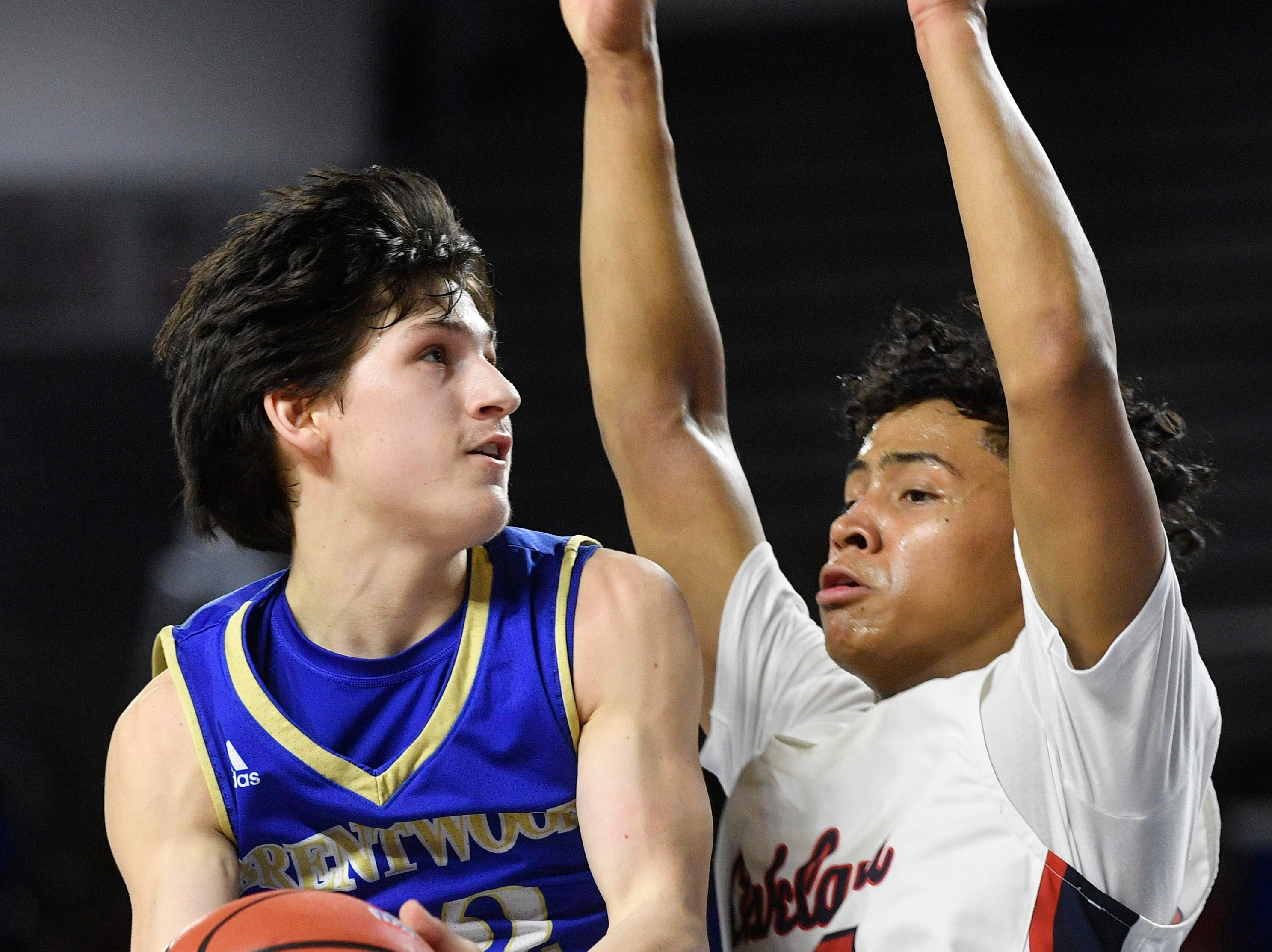 Brentwood's Preston Moore (12) attempts to bet by Oakland's Jaden Jamison (24) as Brentwood plays Oakland in the TSSAA Class AAA quarterfinals Thursday, March 14, 2019, in Murfreesboro, Tenn.
