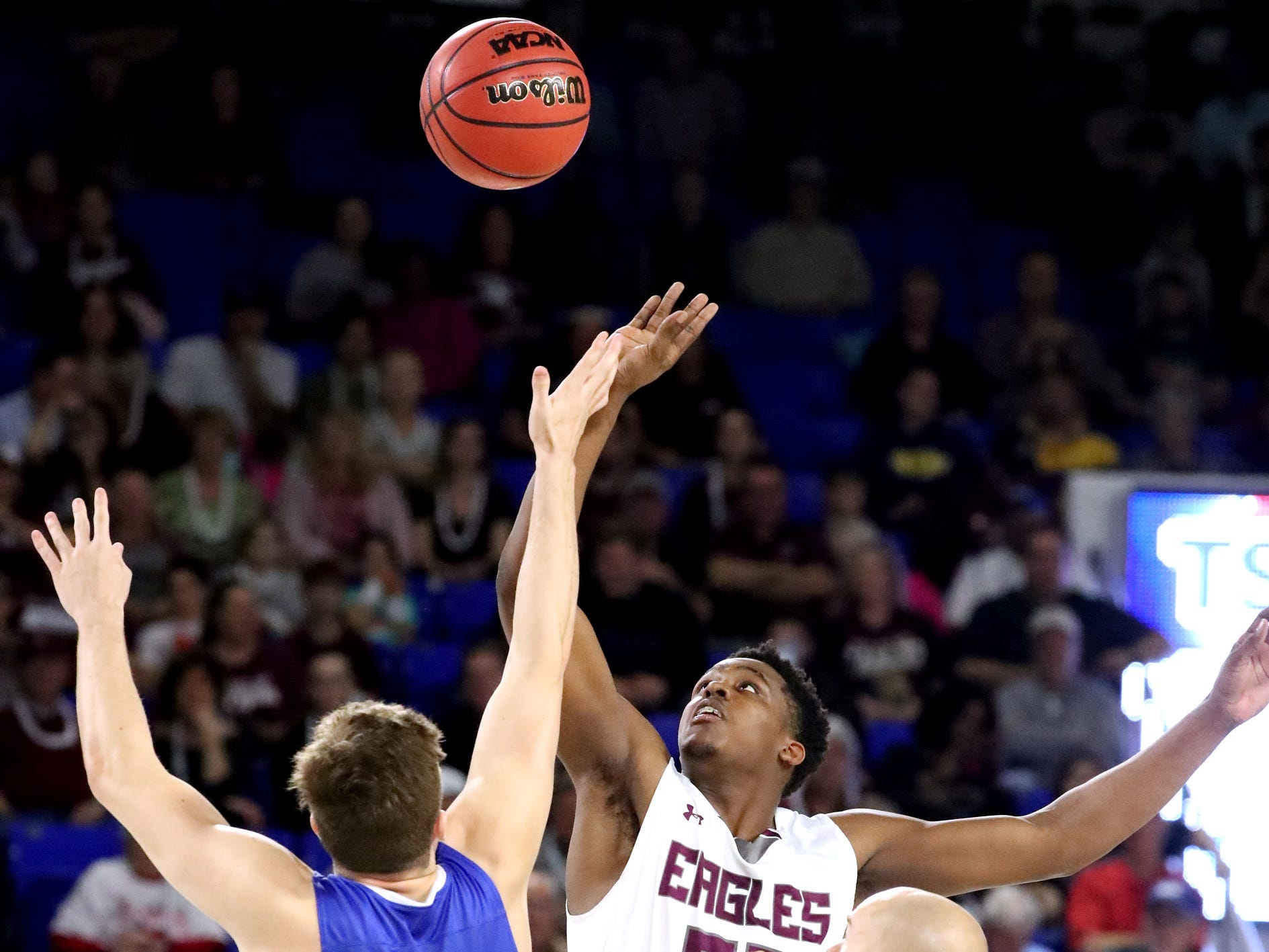 Cosby's Austin McKeehan (13) and Eagleville's Demarious Stoudemire (33) jump the ball to start the quarterfinal round of the TSSAA Class A Boys State Tournament, on Thursday, March 14, 2019, at Murphy Center in Murfreesboro, Tenn.