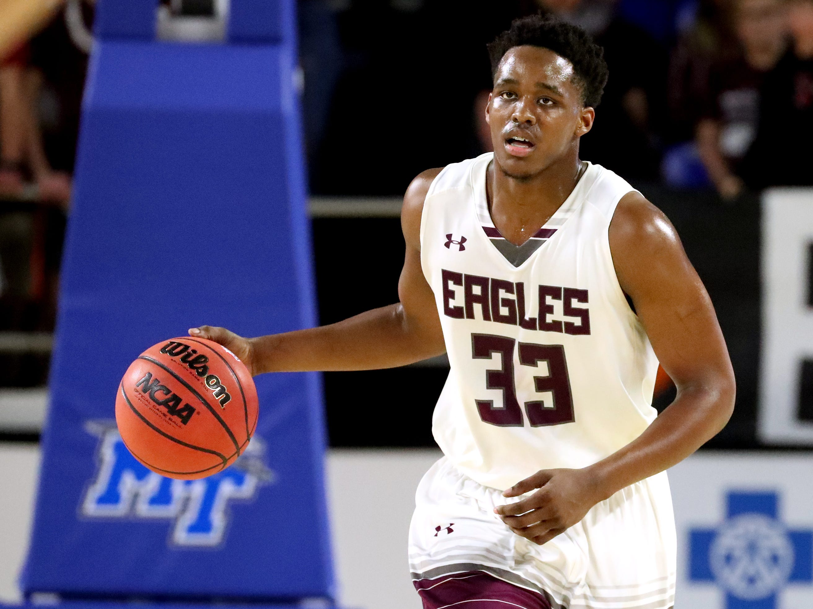 Eagleville's Demarious Stoudemire (33) brings the ball up court during the quarterfinal round of the TSSAA Class A Boys State Tournament against Cosby, on Thursday, March 14, 2019, at Murphy Center in Murfreesboro, Tenn.