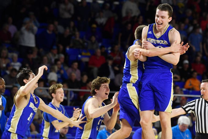 Brentwood's Harry Lackey (22) celebrates with teammates after Brentwood defeated Oakland 50-47 in the TSSAA Class AAA quarterfinals Thursday, March 14, 2019, in Murfreesboro, Tenn.