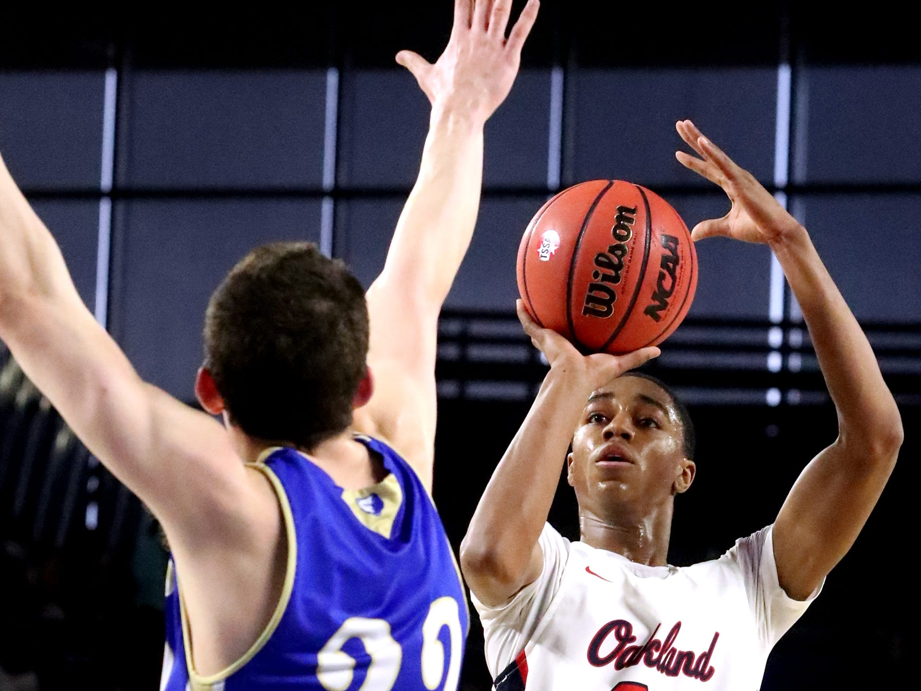 Oakland's Dorian Anderson (23) shoots the ball as Brentwood's Harry Lackey (22) guards him during the quarterfinal round of the TSSAA Class AAA Boys State Tournament, on Thursday, March 14, 2019, at Murphy Center in Murfreesboro, Tenn.