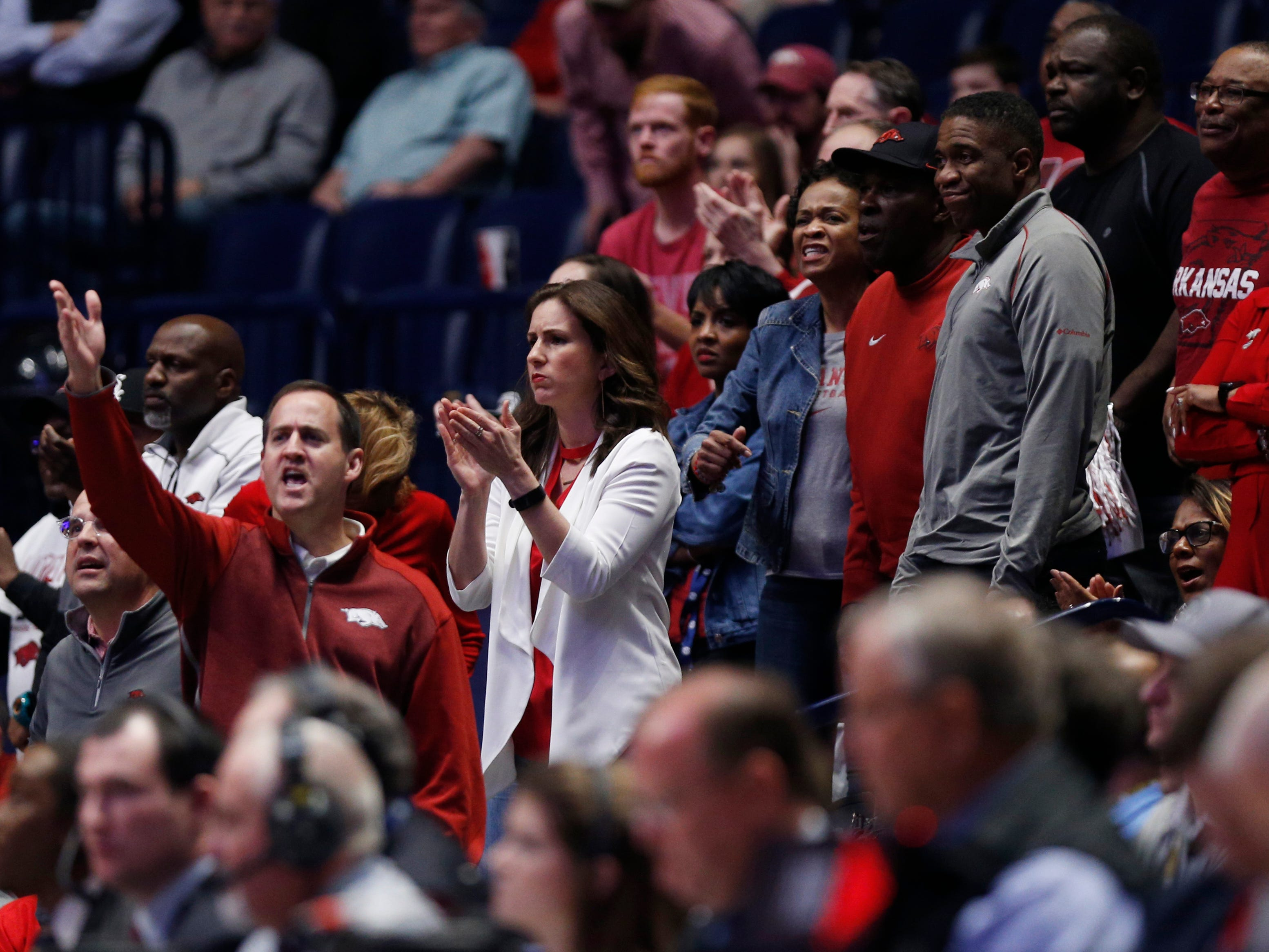 Arkansas fans watch the second half of the SEC Men's Basketball Tournament game at Bridgestone Arena in Nashville, Tenn., Thursday, March 14, 2019.