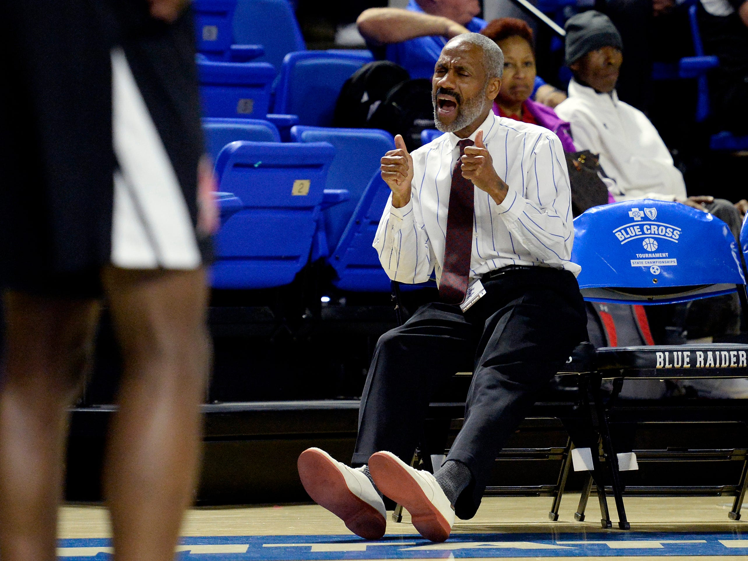 Pearl-Cohn assistant coach James Shelton gestures to players during the second half of an Class AA boys' state basketball quarterfinal game against Brainerd Wednesday, March 13, 2019, in Murfreesboro, Tenn. Brainerd won 76-73.