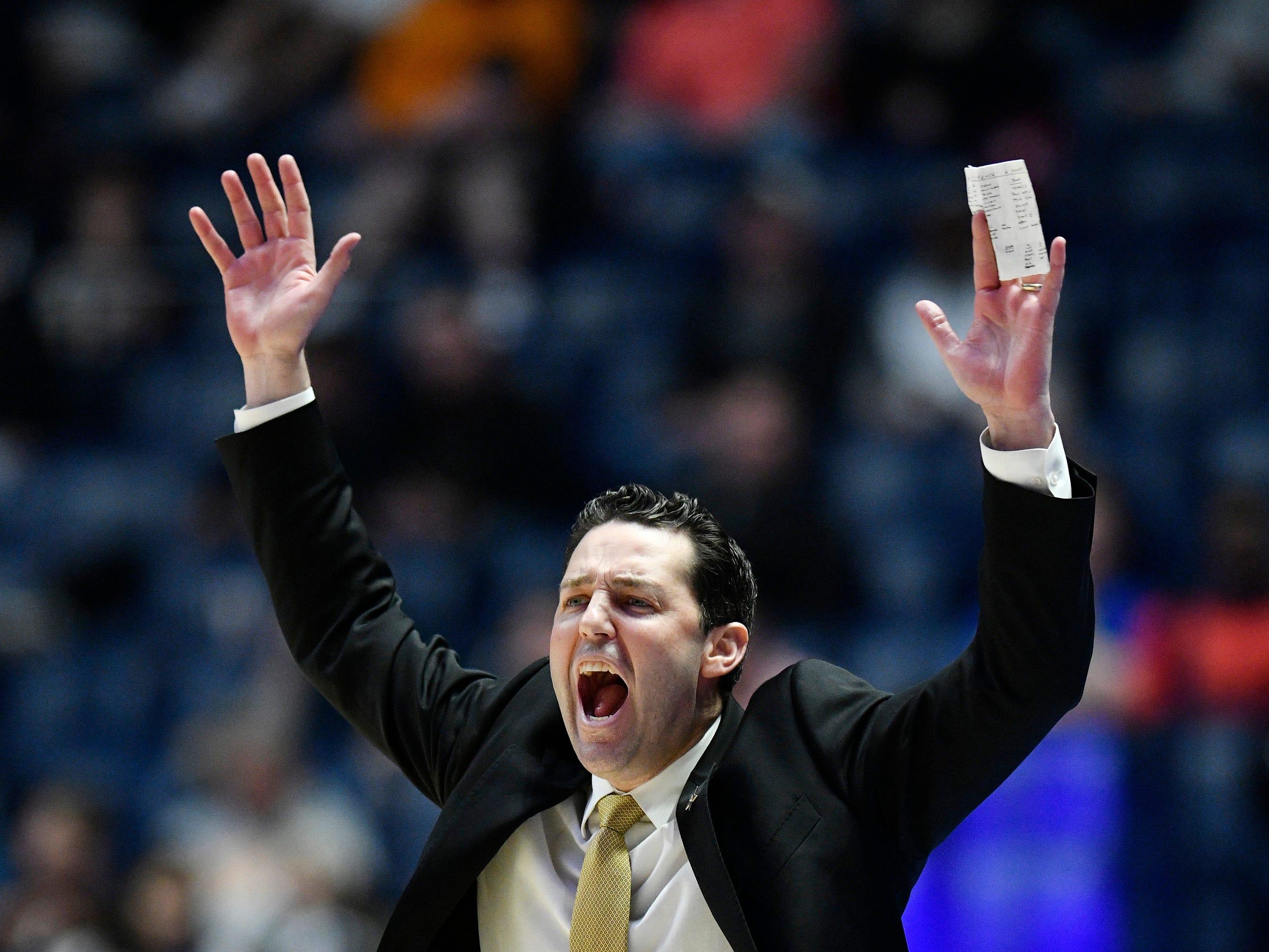 Vanderbilt head coach Bryce Drew yells to his team during the second half of the SEC Men's Basketball Tournament game at Bridgestone Arena in Nashville, Tenn., Wednesday, March 13, 2019.