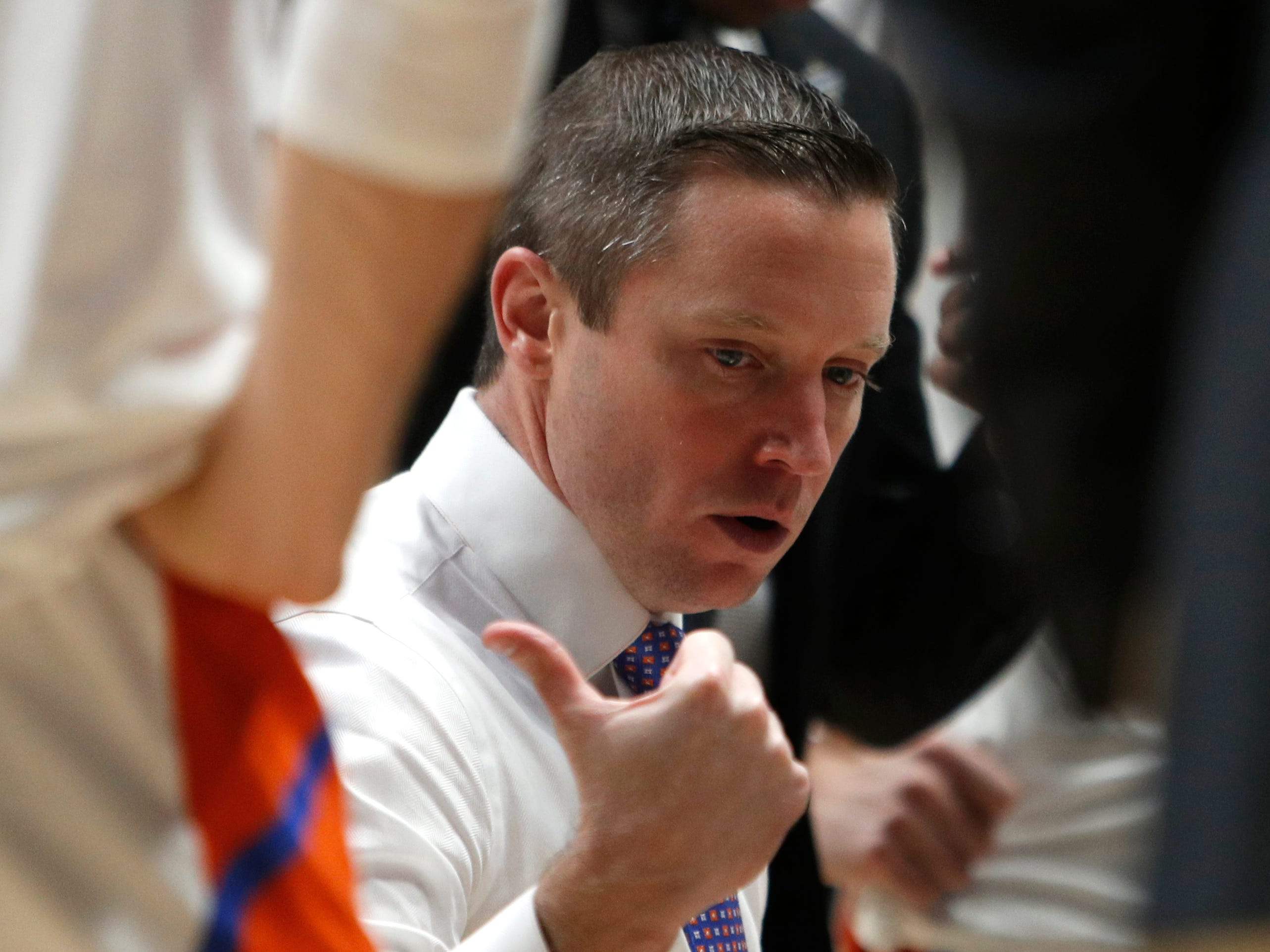 Florida head coach Mike White talks to his players during a timeout in the first half of the SEC Men's Basketball Tournament game at Bridgestone Arena in Nashville, Tenn., Thursday, March 14, 2019.