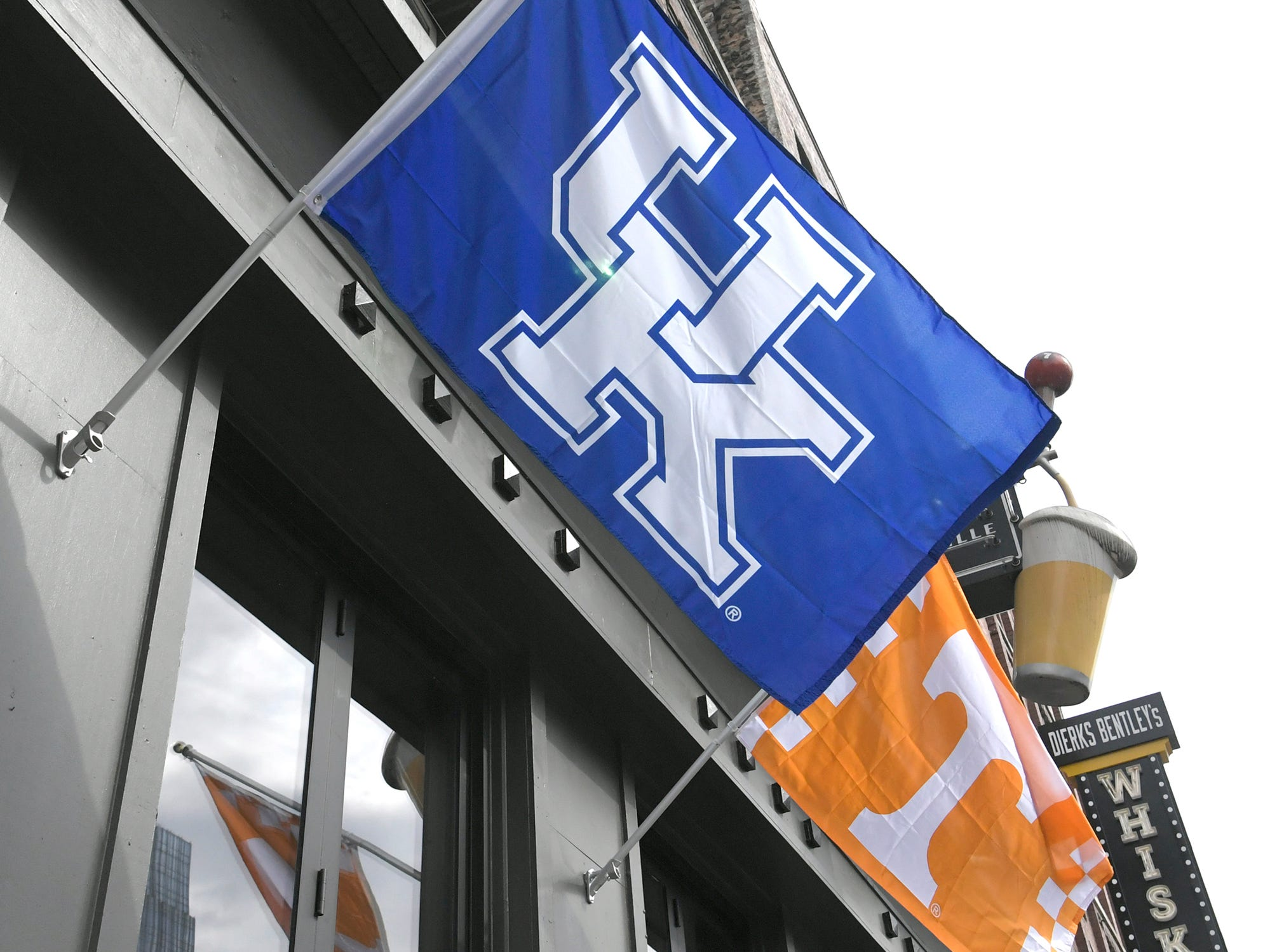 Kentucky and Tennessee flags fly along Broadway during the SEC Mens Basketball Tournament in Nashville on Thursday, March 14, 2019.