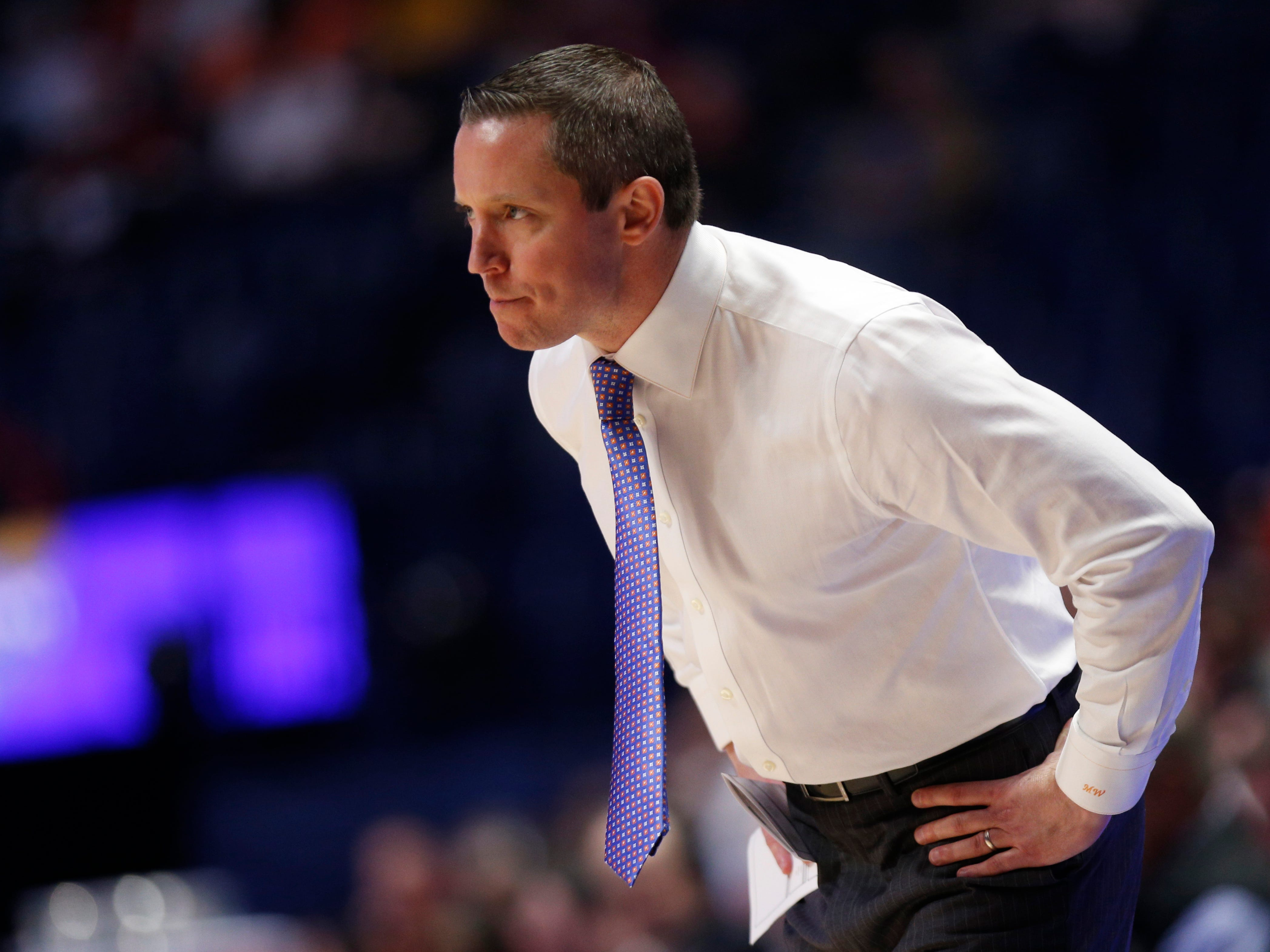 Florida head coach Mike White watches the action in the first half of the SEC Men's Basketball Tournament game at Bridgestone Arena in Nashville, Tenn., Thursday, March 14, 2019.