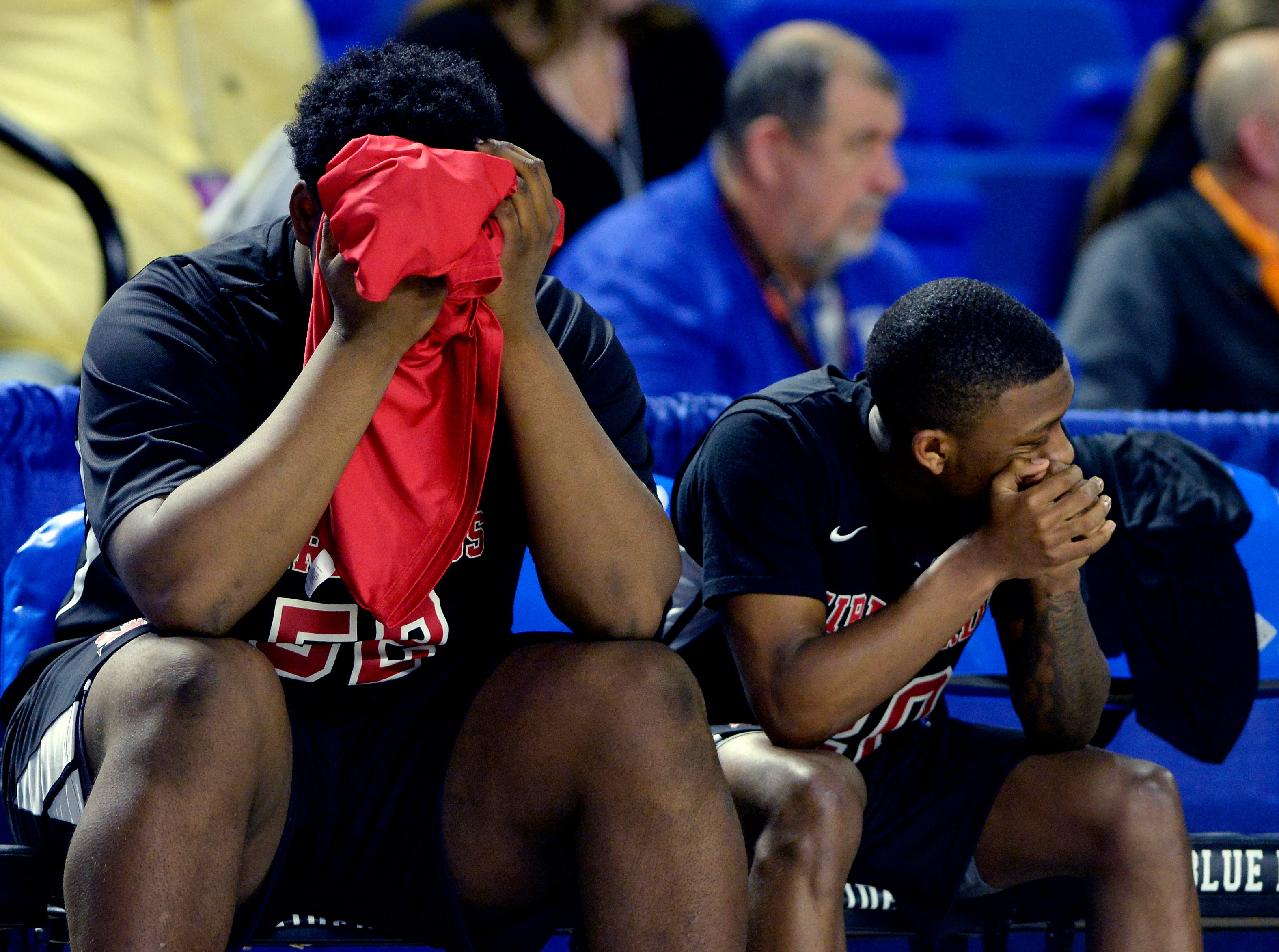 Pearl-Cohn forward Wiiliam Griffin, left, and guard Bobby Byrd (20) sit on the bench dejected as the final seconds run off the clock during the second half of an Class AA boys' state basketball quarterfinal game against Brainerd Wednesday, March 13, 2019, in Murfreesboro, Tenn. Brainerd won 76-73.