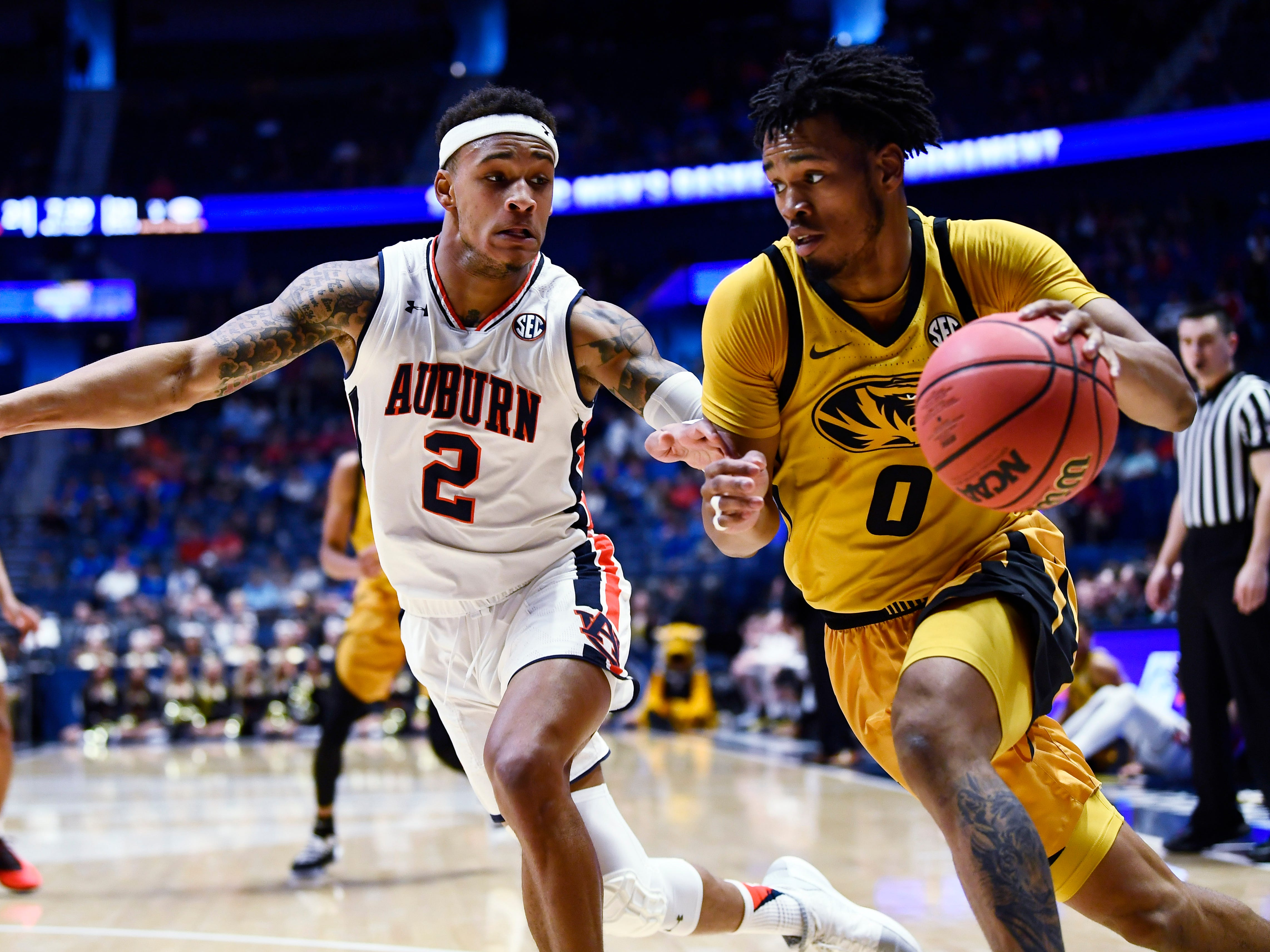 Missouri guard Torrence Watson (0) moves the ball defended by Auburn guard Bryce Brown (2) during the first half of the SEC Men's Basketball Tournament game at Bridgestone Arena in Nashville, Tenn., Thursday, March 14, 2019.