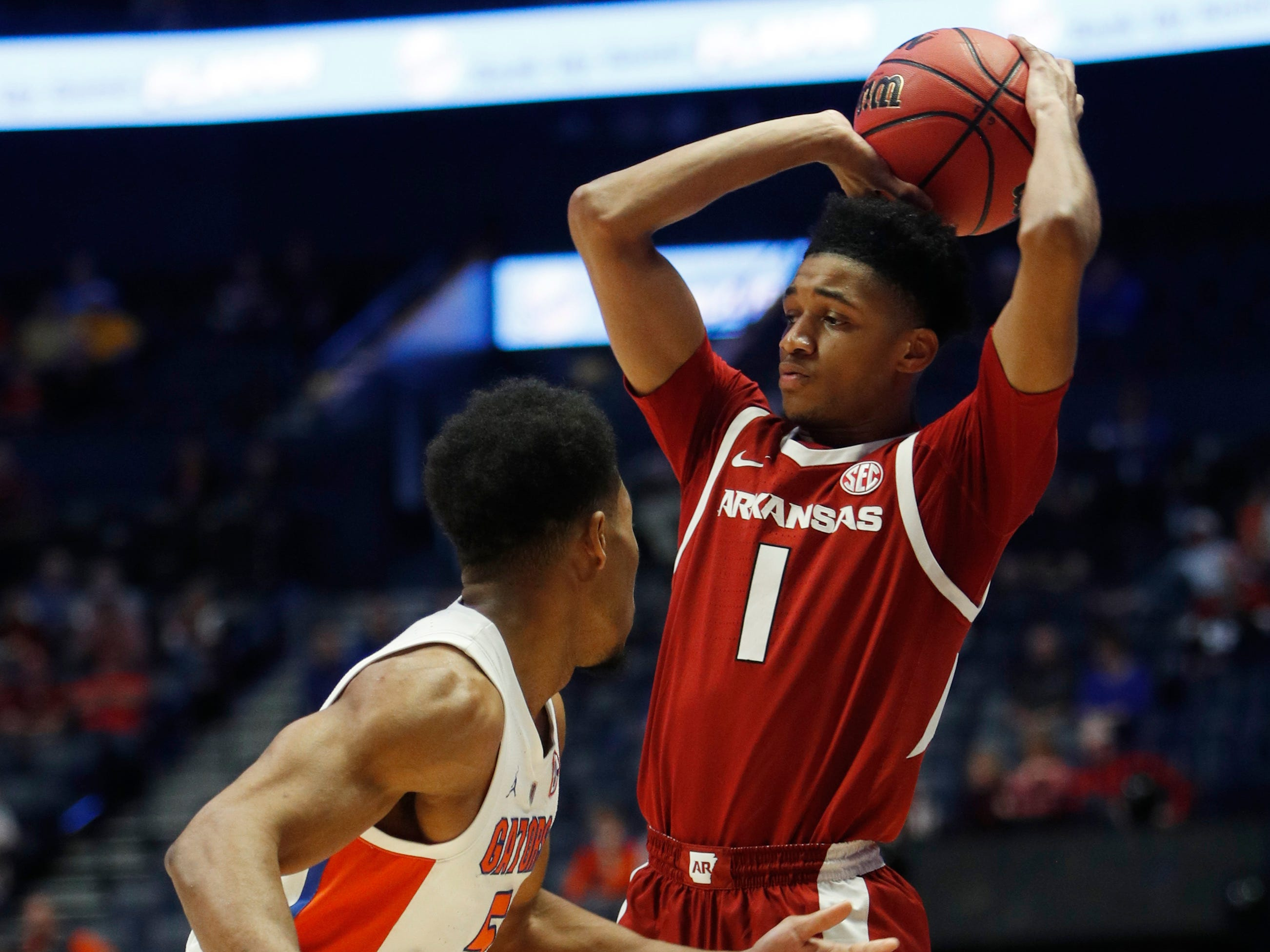 Arkansas guard Isaiah Joe (1) tries to move the ball defended by Florida guard KeVaughn Allen (5) during the first half of the SEC Men's Basketball Tournament game at Bridgestone Arena in Nashville, Tenn., Thursday, March 14, 2019.