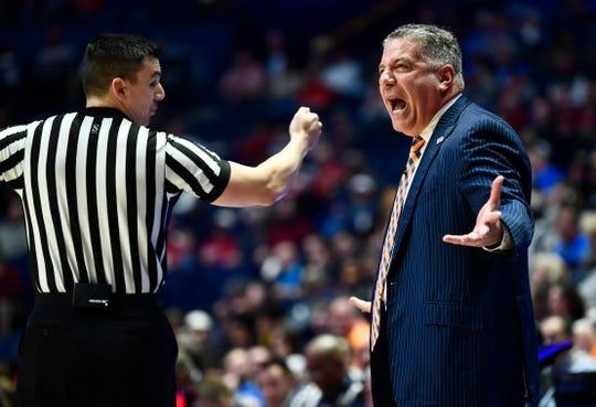 Auburn head coach Bruce Pearl yells during the first half of the SEC Men's Basketball Tournament game at Bridgestone Arena in Nashville, Tenn., Thursday, March 14, 2019.