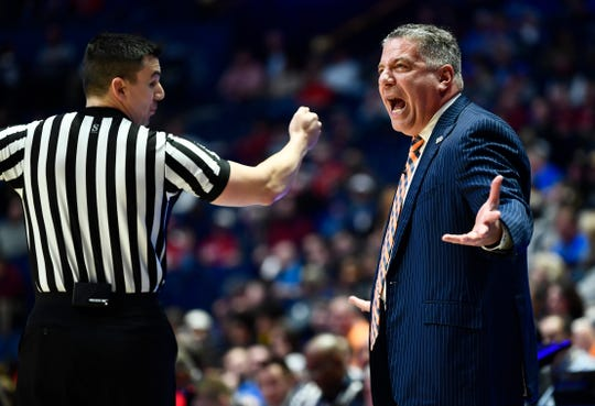 Auburn head coach Bruce Pearl yells during the first half of the SEC Men's Basketball Tournament game at Bridgestone Arena in Nashville, Tenn., Thursday, March 14, 2019.