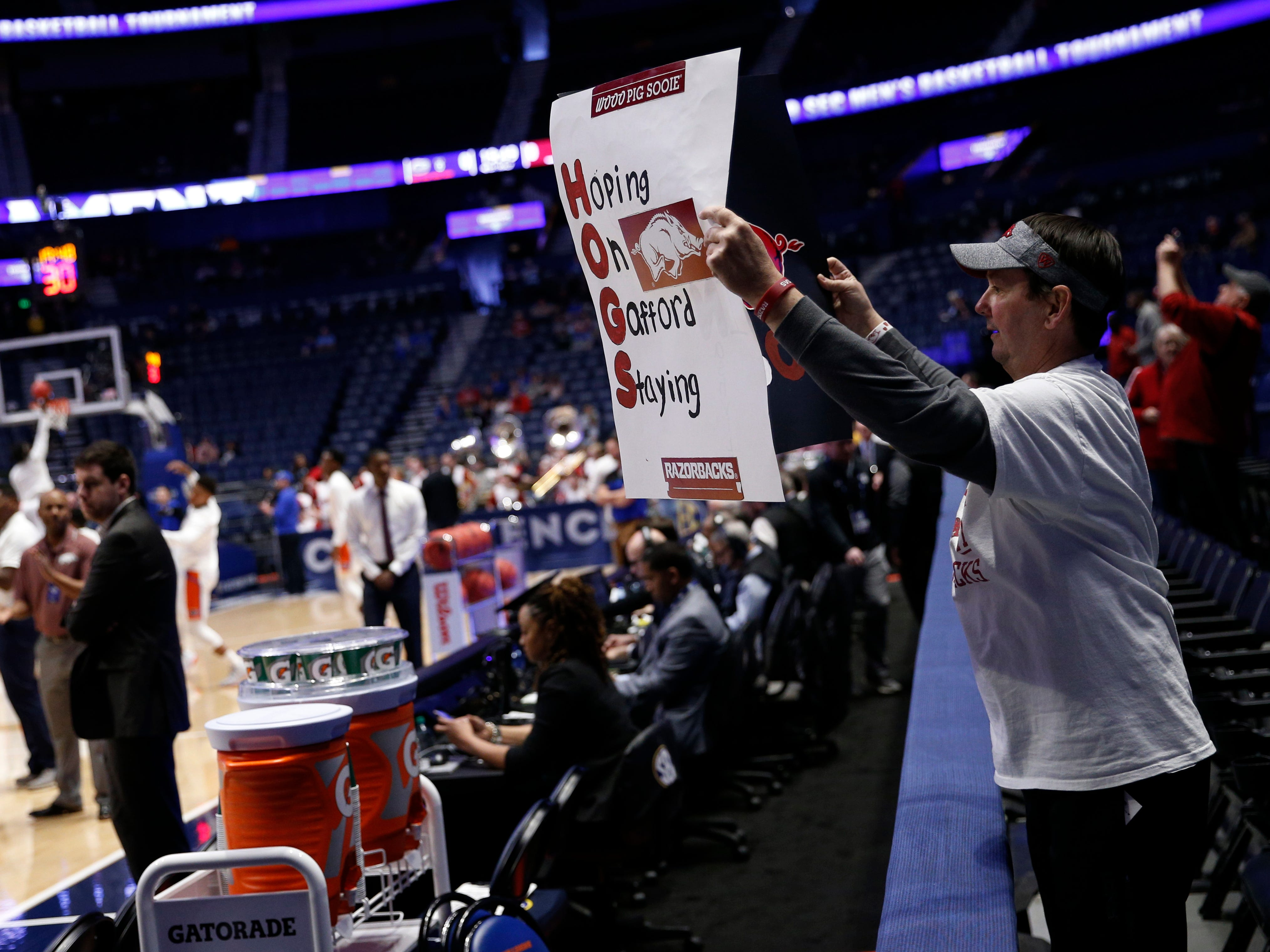 An Arkansas fan holds a sign for the team as it comes onto the court before the SEC Men's Basketball Tournament game at Bridgestone Arena in Nashville, Tenn., Thursday, March 14, 2019.