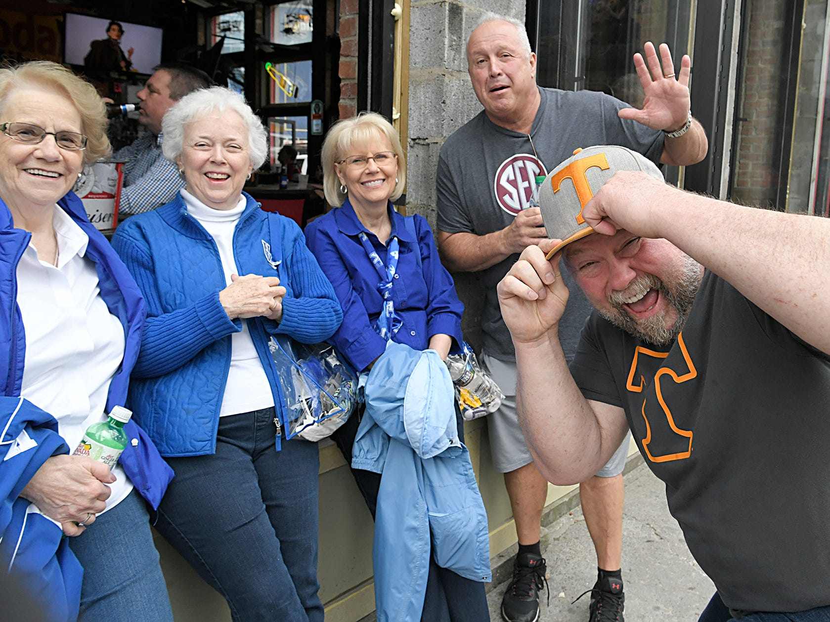 Kentucky fans Faye Warfield, Dee Hayes and Anna Raines have fun with UT fans Aaron Taubert and Johnny Lowe on Broadway during the SEC Mens Basketball Tournament in Nashville on Thursday, March 14, 2019.