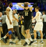 Vanderbilt forward Matt Ryan (32) reacts at the end of the team's loss to Texas A&M in the SEC Men's Basketball Tournament at Bridgestone Arena in Nashville, Tenn., Wednesday, March 13, 2019.