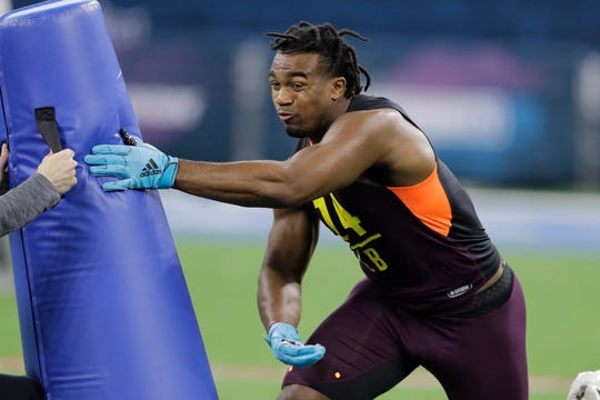 Texas A&M linebacker Tyrel Dodson runs a drill during the NFL football scouting combine, Sunday, March 3, 2019, in Indianapolis.