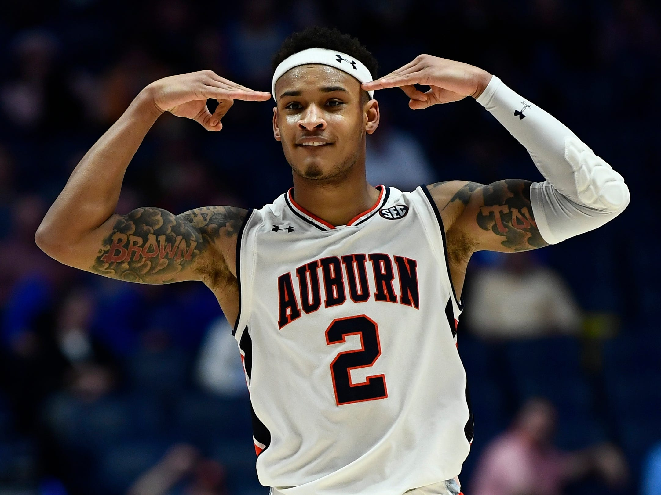 Auburn guard Bryce Brown (2) celebrates his three-pointer during the second half of the SEC Men's Basketball Tournament game at Bridgestone Arena in Nashville, Tenn., Thursday, March 14, 2019.