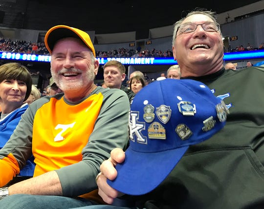Best friends Mike Peery, a UT fan, and Rick Napper, a KY fan, have gone to 15 SEC tournaments in a row together.  They sit together at the SEC Men's Basketball Tournament in Nashville on Thursday, March 14, 2019.