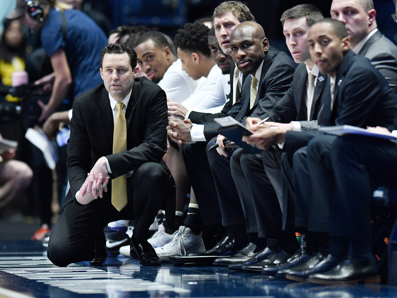 Vanderbilt head coach Bryce Drew watches the action during the first half of the SEC Men's Basketball Tournament game at Bridgestone Arena in Nashville, Tenn., Wednesday, March 13, 2019.