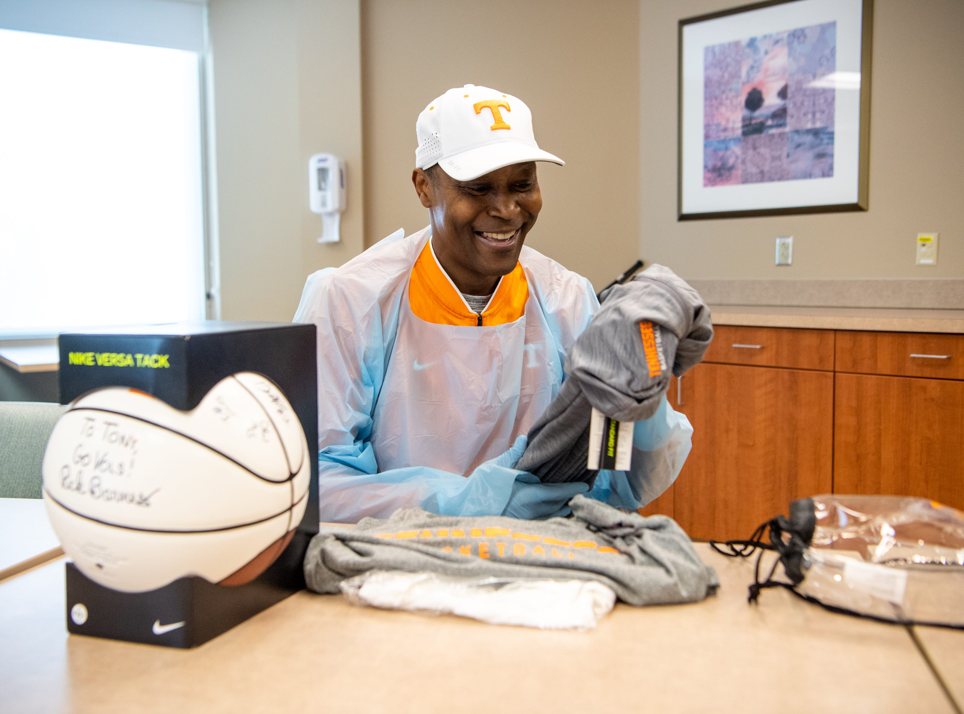 Former UT player Tony White, who is battling leukemia, holds up the jacket he received from the Tennessee Volunteers men's basketball team at Sarah Cannon Cancer Institute at TriStar Centennial on Thursday, March 14, 2019, in Nashville, Tenn.