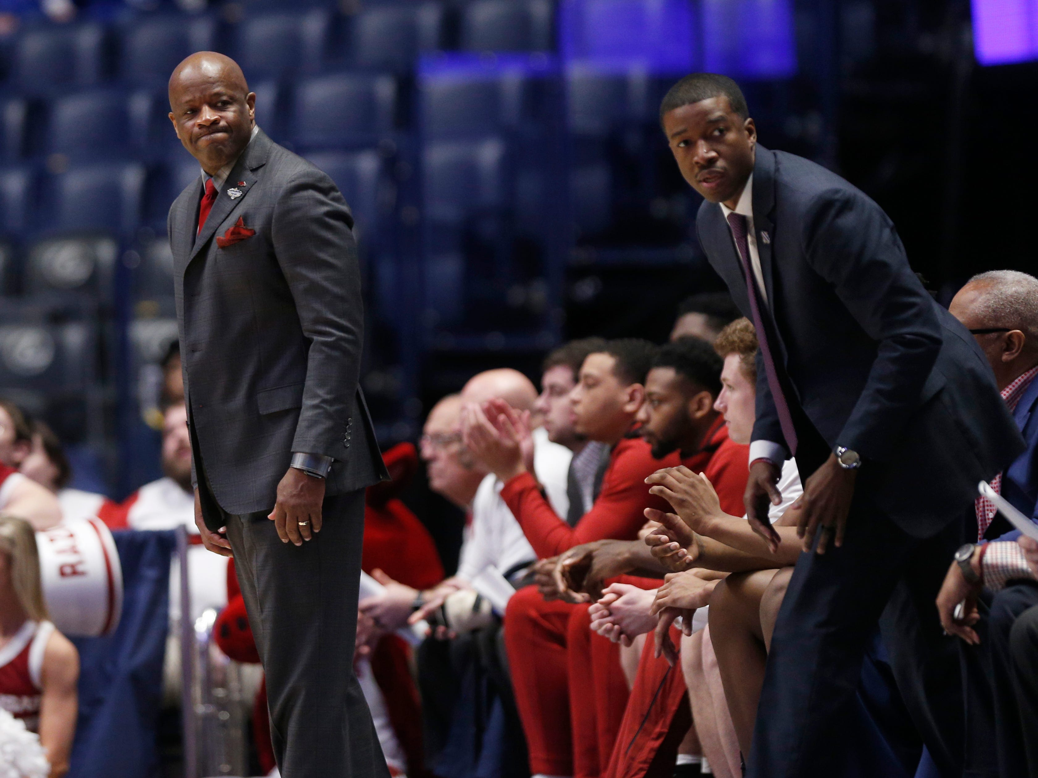 Arkansas head coach Mike Anderson and assistant coach TJ Cleveland watch the team during the first half of the SEC Men's Basketball Tournament game at Bridgestone Arena in Nashville, Tenn., Thursday, March 14, 2019.