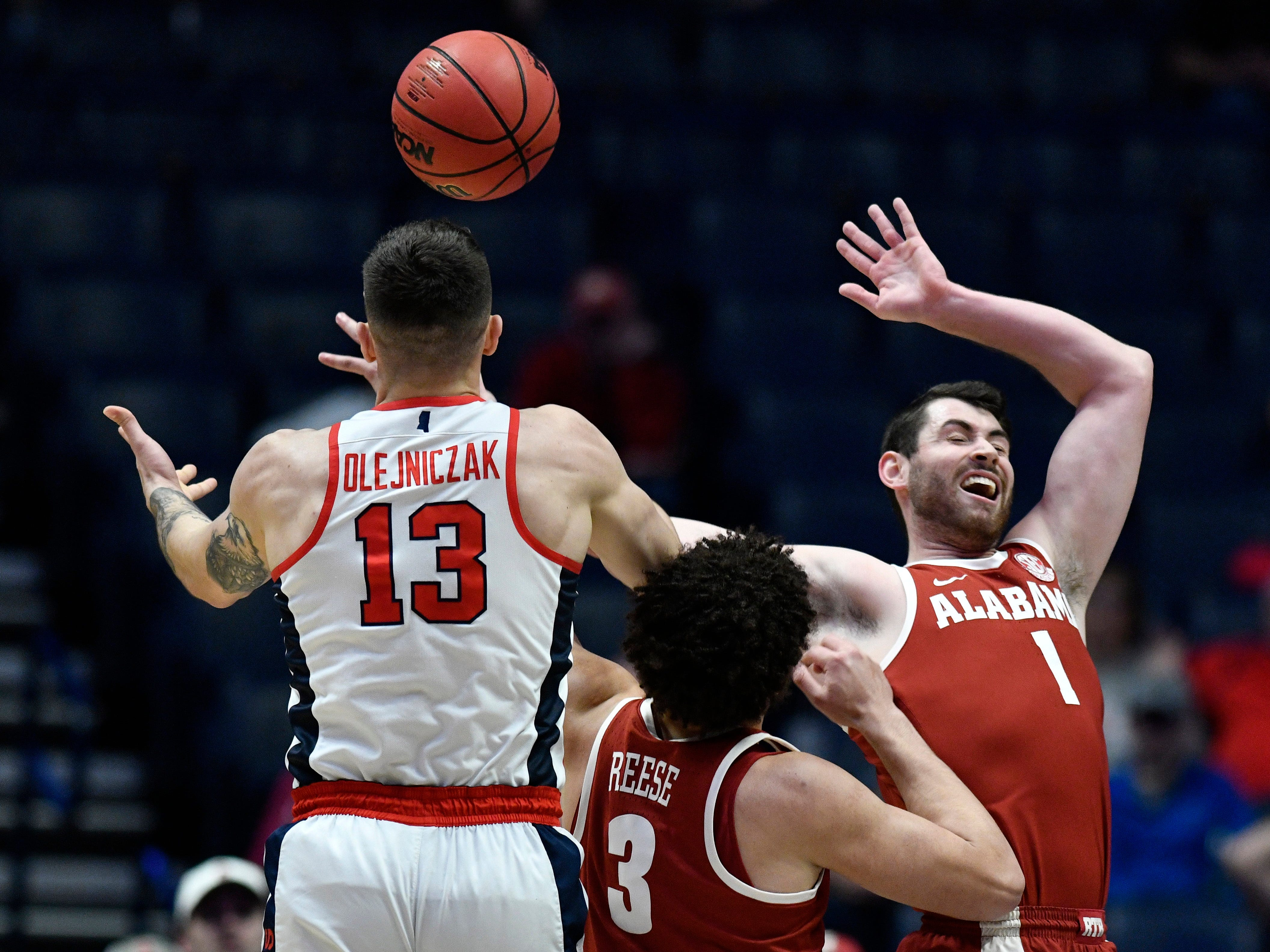 Alabama guard/forward Riley Norris (1), forward Alex Reese (3) and Ole Miss center Dominik Olejniczak (13) battle for the ball during the first half of the SEC Men's Basketball Tournament game at Bridgestone Arena in Nashville, Tenn., Thursday, March 14, 2019.