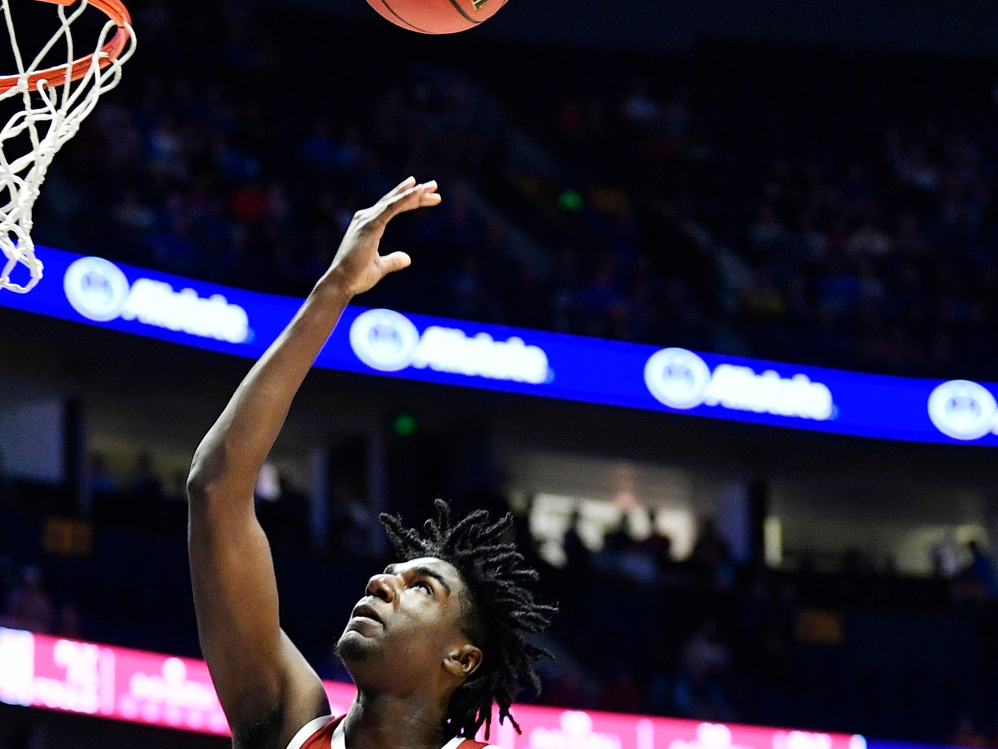 Alabama guard Kira Lewis Jr. (2) tosses up a shot during the first half of the SEC Men's Basketball Tournament game at Bridgestone Arena in Nashville, Tenn., Thursday, March 14, 2019.