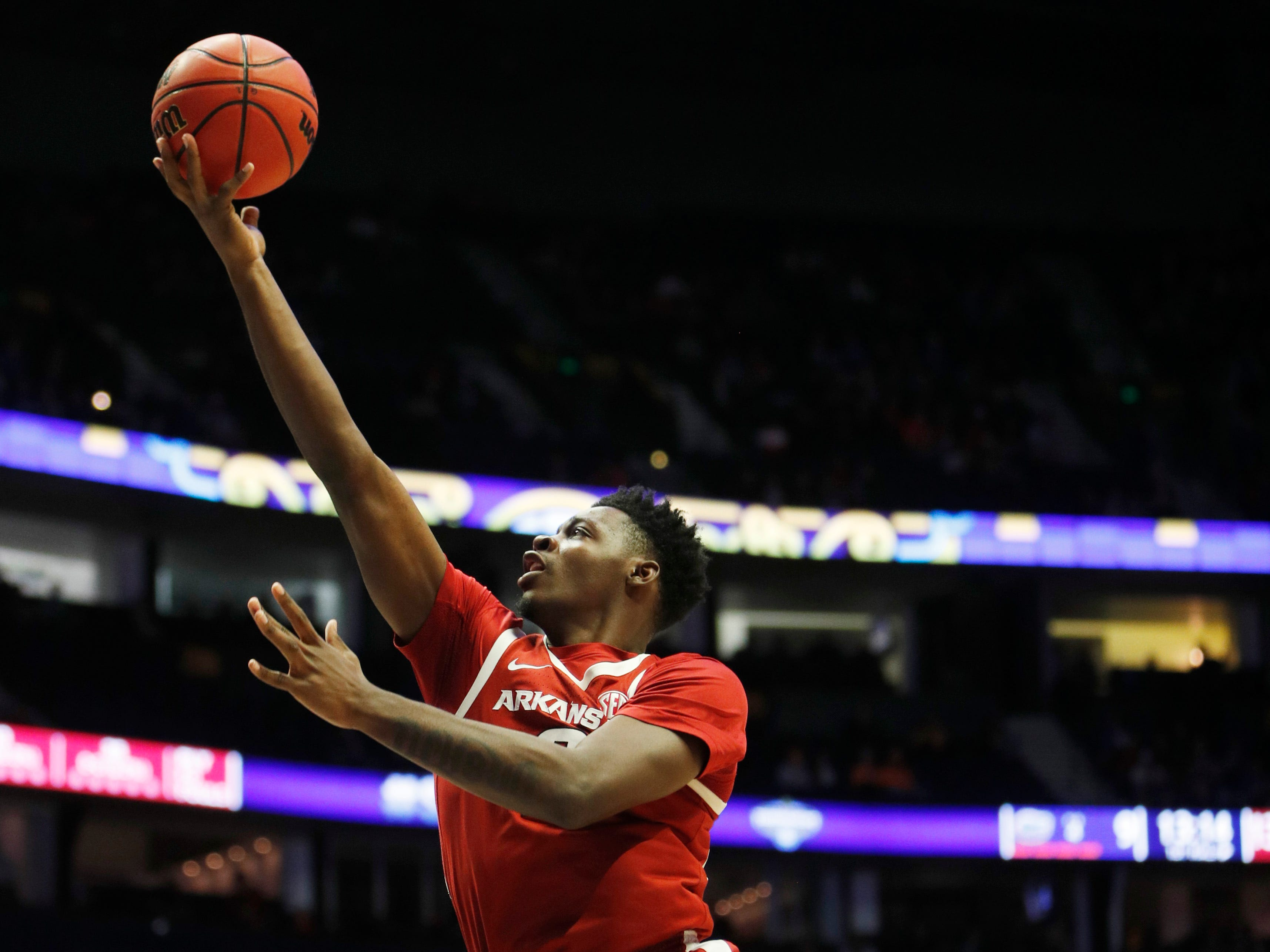 Arkansas forward Adrio Bailey (2) goes to the basket during the first half of the SEC Men's Basketball Tournament game at Bridgestone Arena in Nashville, Tenn., Thursday, March 14, 2019.
