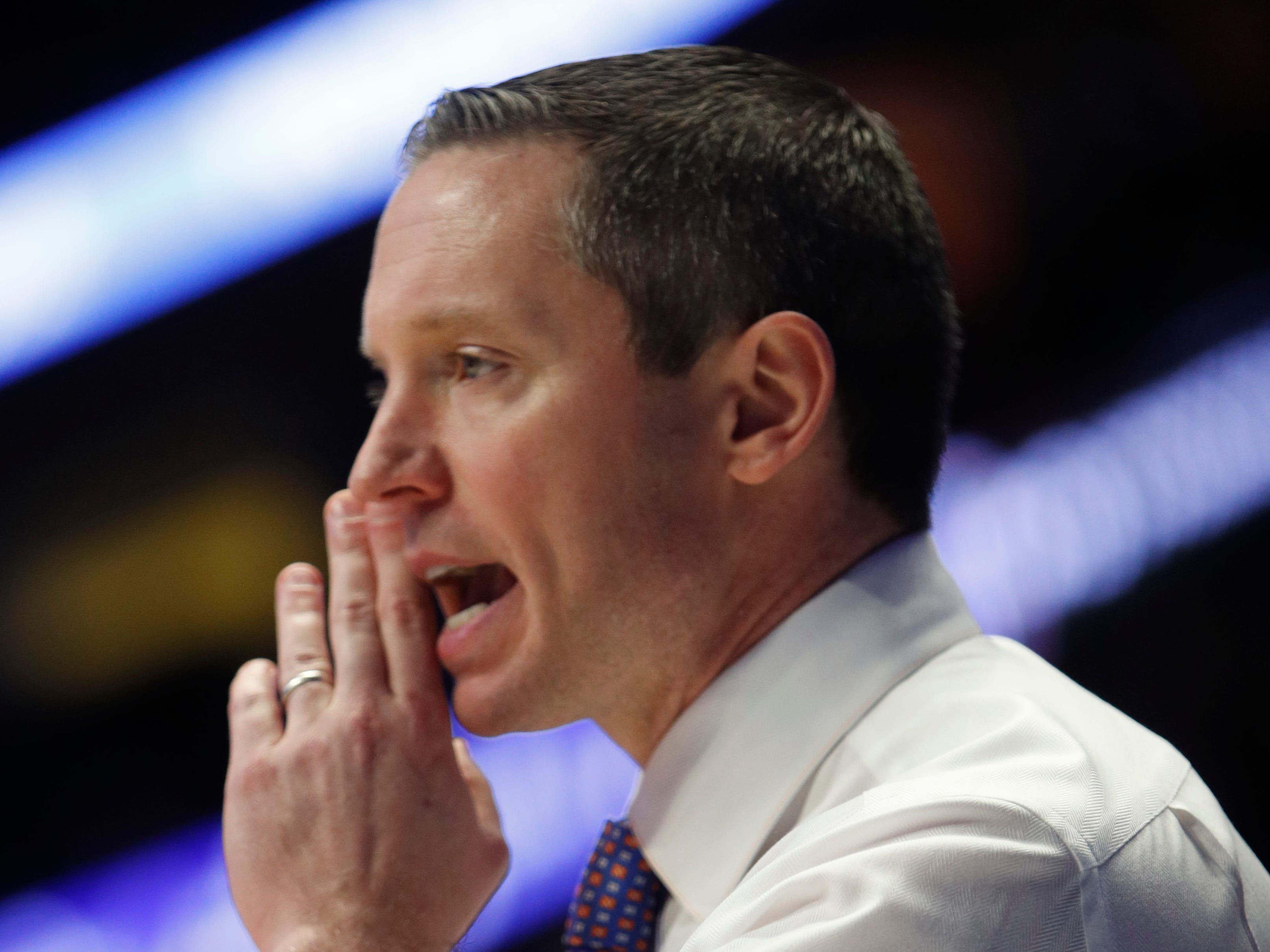 Florida head coach Mike White yells to his team during the second half of the SEC Men's Basketball Tournament game at Bridgestone Arena in Nashville, Tenn., Thursday, March 14, 2019.