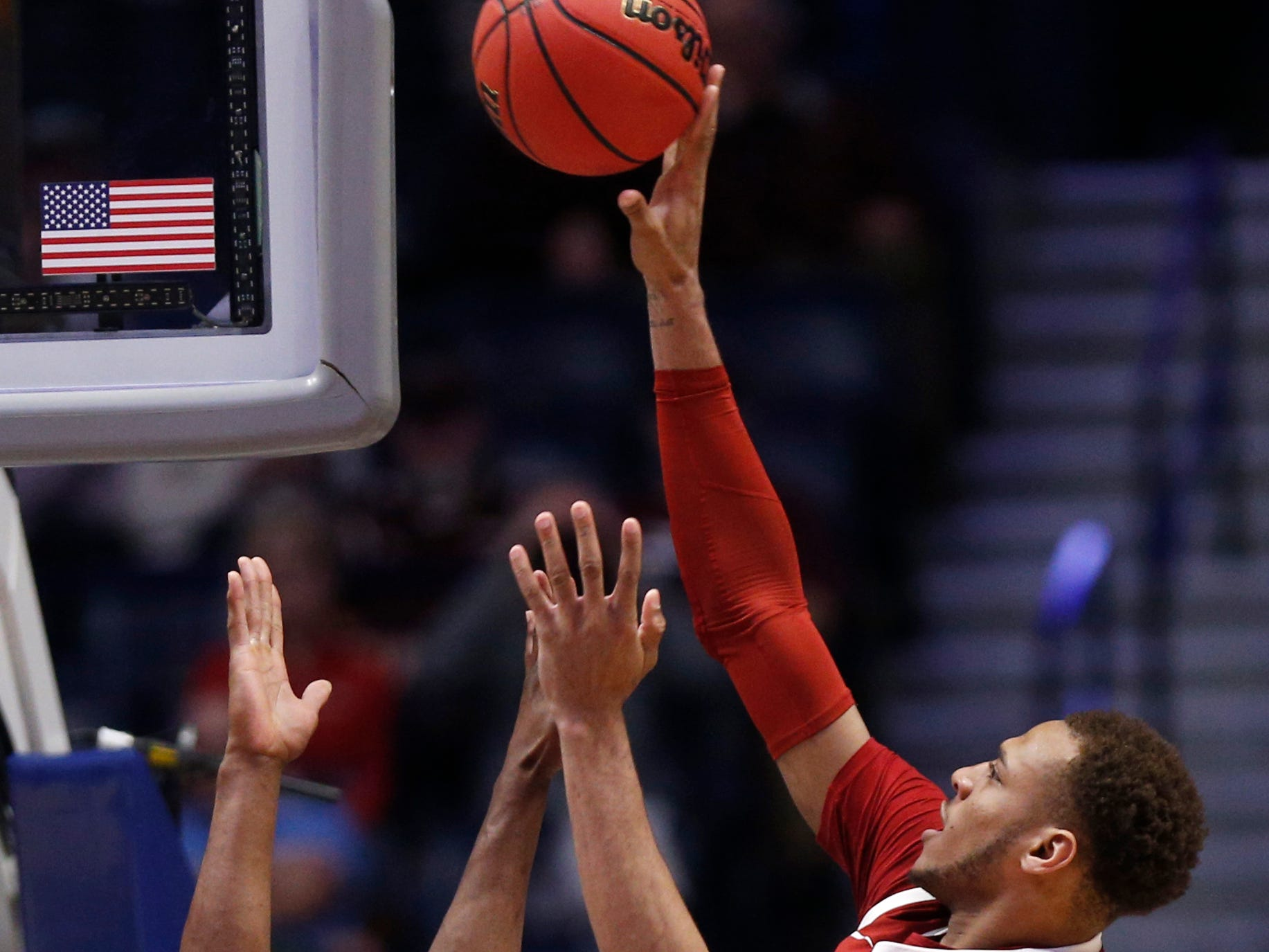Arkansas forward Daniel Gafford (10) goes up for a shot defended by Florida center Kevarrius Hayes (13) during the second half of the SEC Men's Basketball Tournament game at Bridgestone Arena in Nashville, Tenn., Thursday, March 14, 2019.