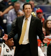 Vanderbilt head coach Bryce Drew watches the action during the first half of the SEC Men's Basketball Tournament game at Bridgestone Arena in Nashville, Tenn., Wednesday, March 13, 2019.