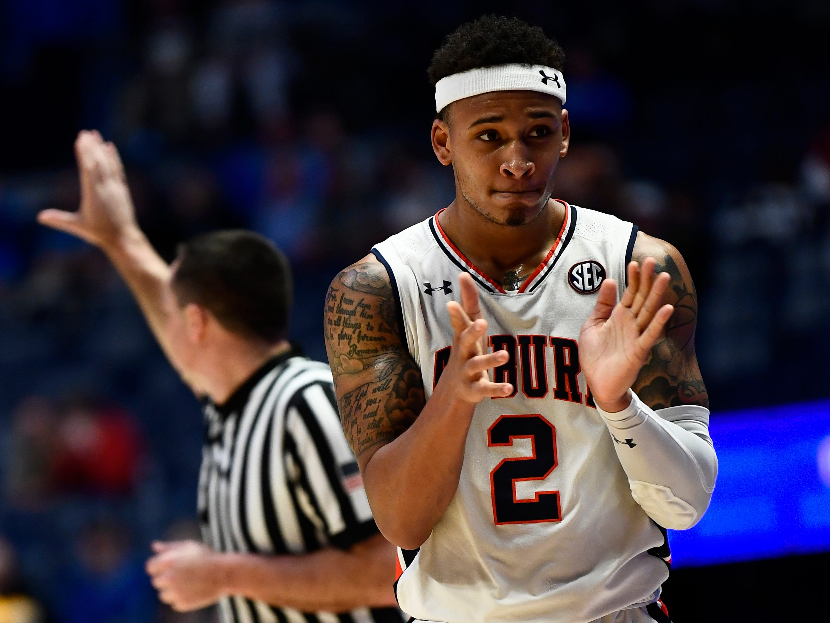 Auburn guard Bryce Brown (2) celebrates in the closing seconds of the second half of the SEC Men's Basketball Tournament game at Bridgestone Arena in Nashville, Tenn., Thursday, March 14, 2019.