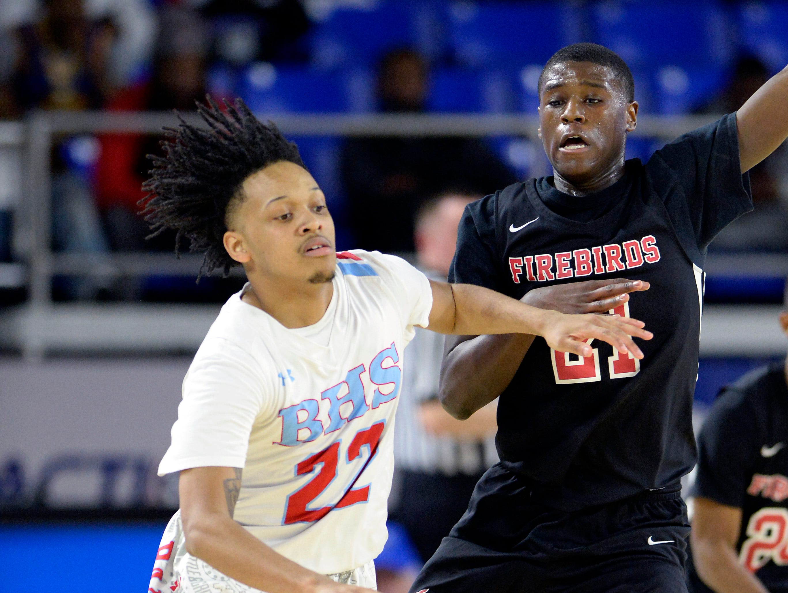 Brainerd guard Cavonte McKibbens (22) drives past Pearl-Cohn guard Antonio Anthony (21) during the first half of an Class AA boys' state basketball quarterfinal game against Brainerd Wednesday, March 13, 2019, in Murfreesboro, Tenn.
