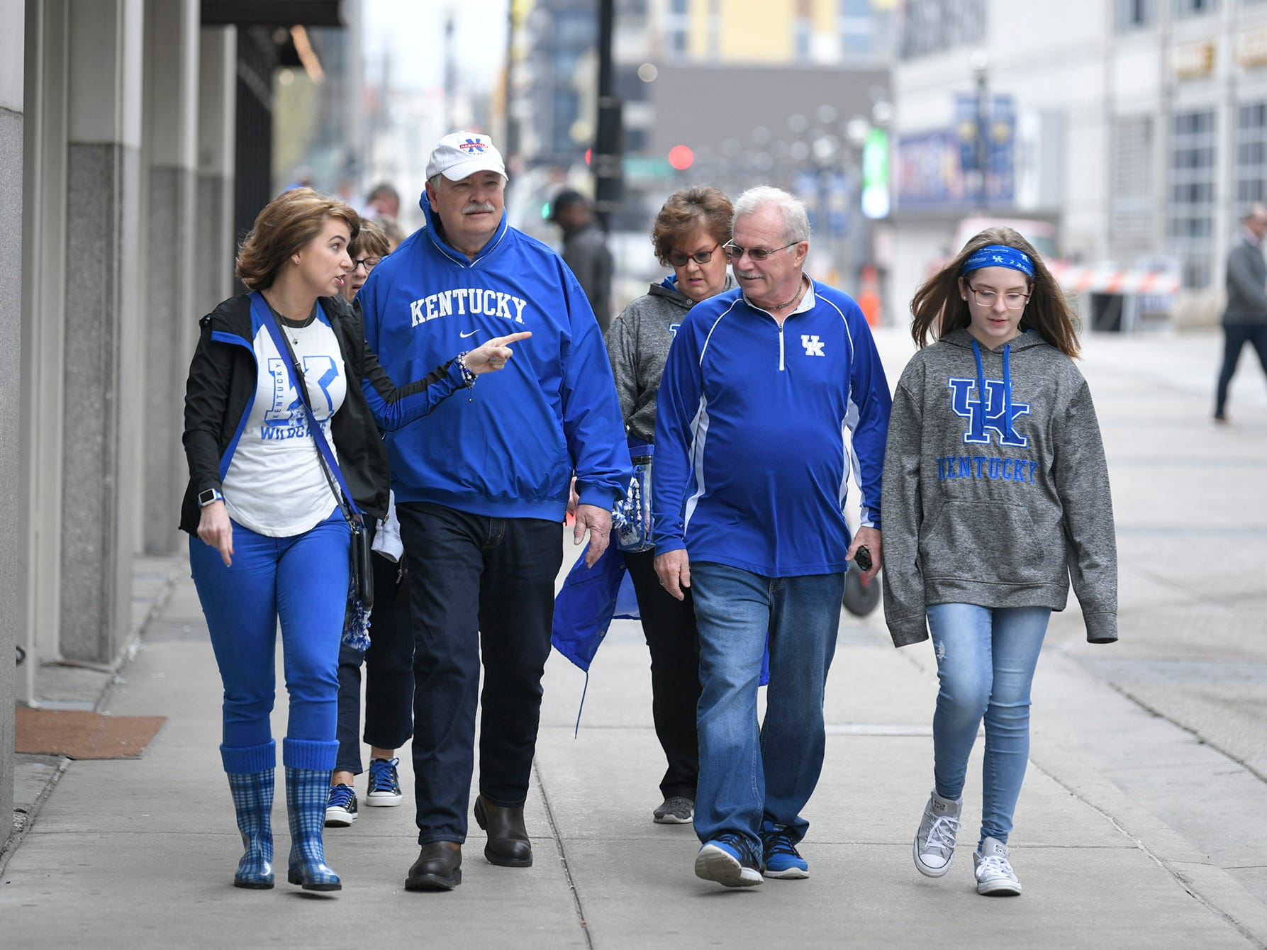Kentucky fans April Peal, Jim Primm, Ricky Peal and Brooklyn Swatzell walk through downtown Nashville on Thursday, March 14, 2019. The group arrived early to watch the SEC Men's Basketball Tournament in Nashville.