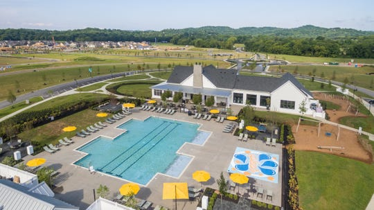 An aerial view of The farmhouse at Durham Farms shows the pool, splash pad and playground.