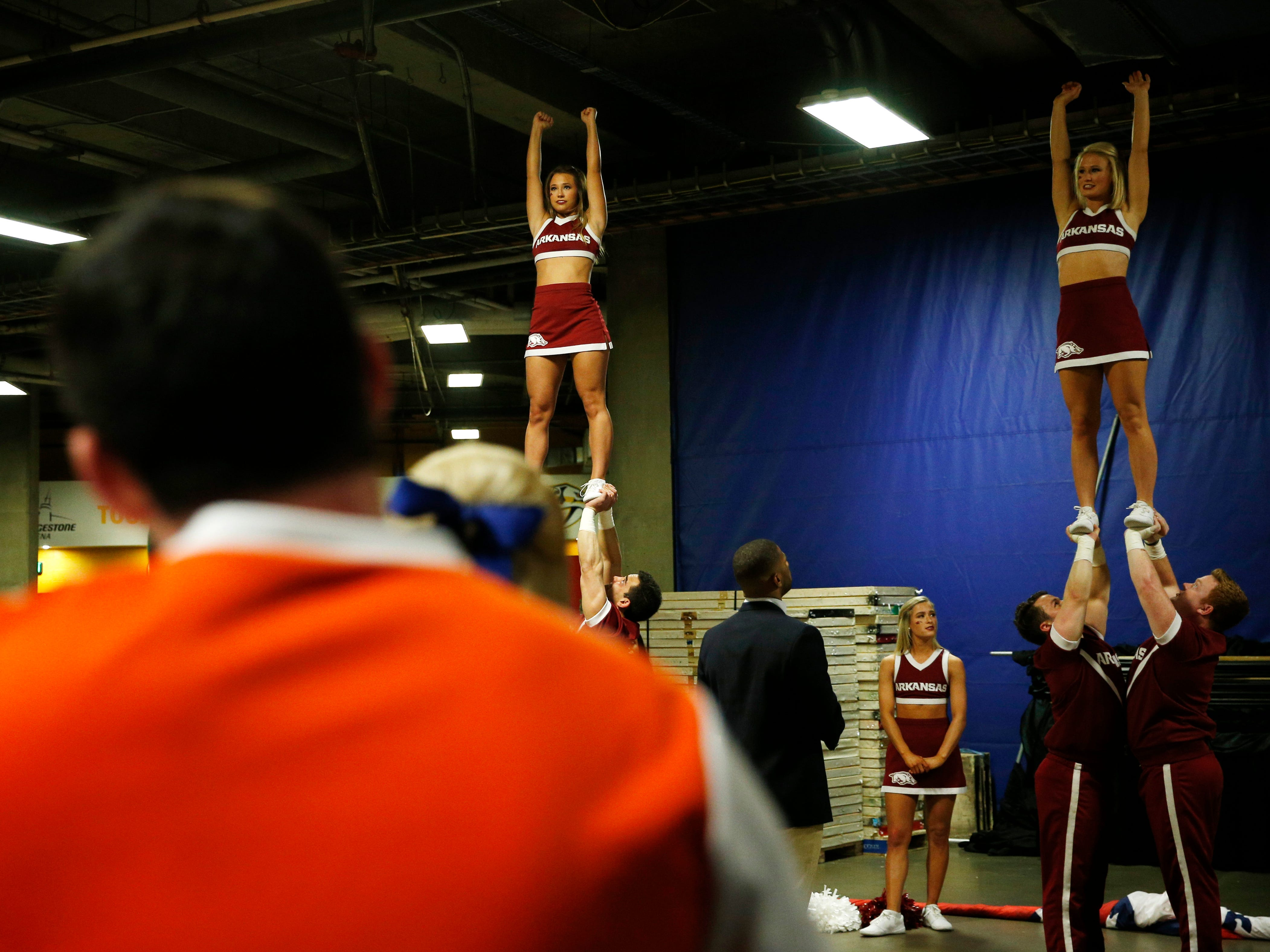 Florida cheer squad members watch Arkansas cheerleaders practice before the SEC Men's Basketball Tournament game at Bridgestone Arena in Nashville, Tenn., Thursday, March 14, 2019.