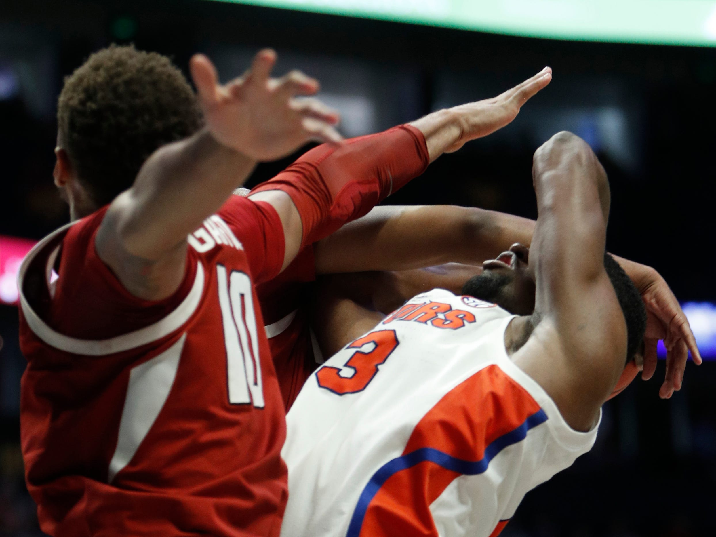Florida guard Jalen Hudson (3) gets tangled up with Arkansas defenders during the second half of the SEC Men's Basketball Tournament game at Bridgestone Arena in Nashville, Tenn., Thursday, March 14, 2019.