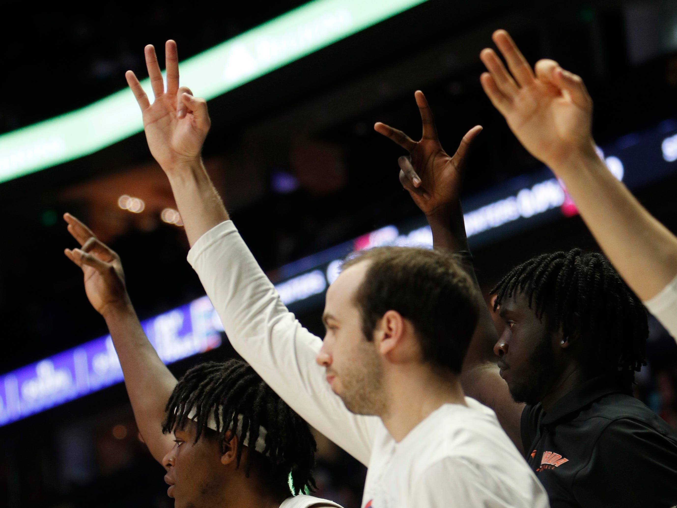 Florida players signal a three-pointer during the first half of the SEC Men's Basketball Tournament game at Bridgestone Arena in Nashville, Tenn., Thursday, March 14, 2019.