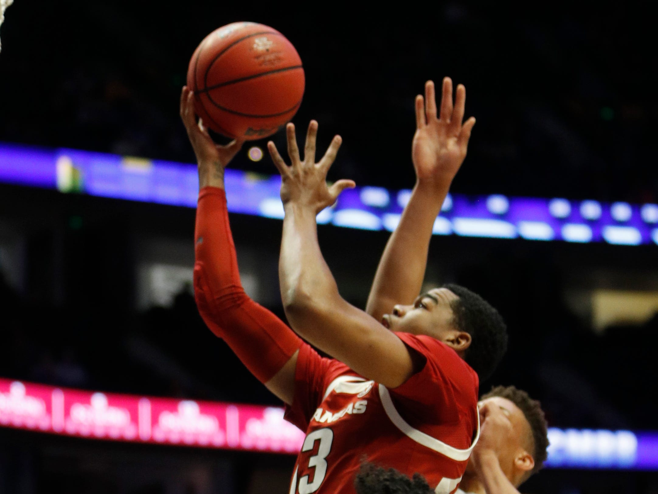 Arkansas guard Mason Jones (13) goes up for a shot during the first half of the SEC Men's Basketball Tournament game at Bridgestone Arena in Nashville, Tenn., Thursday, March 14, 2019.